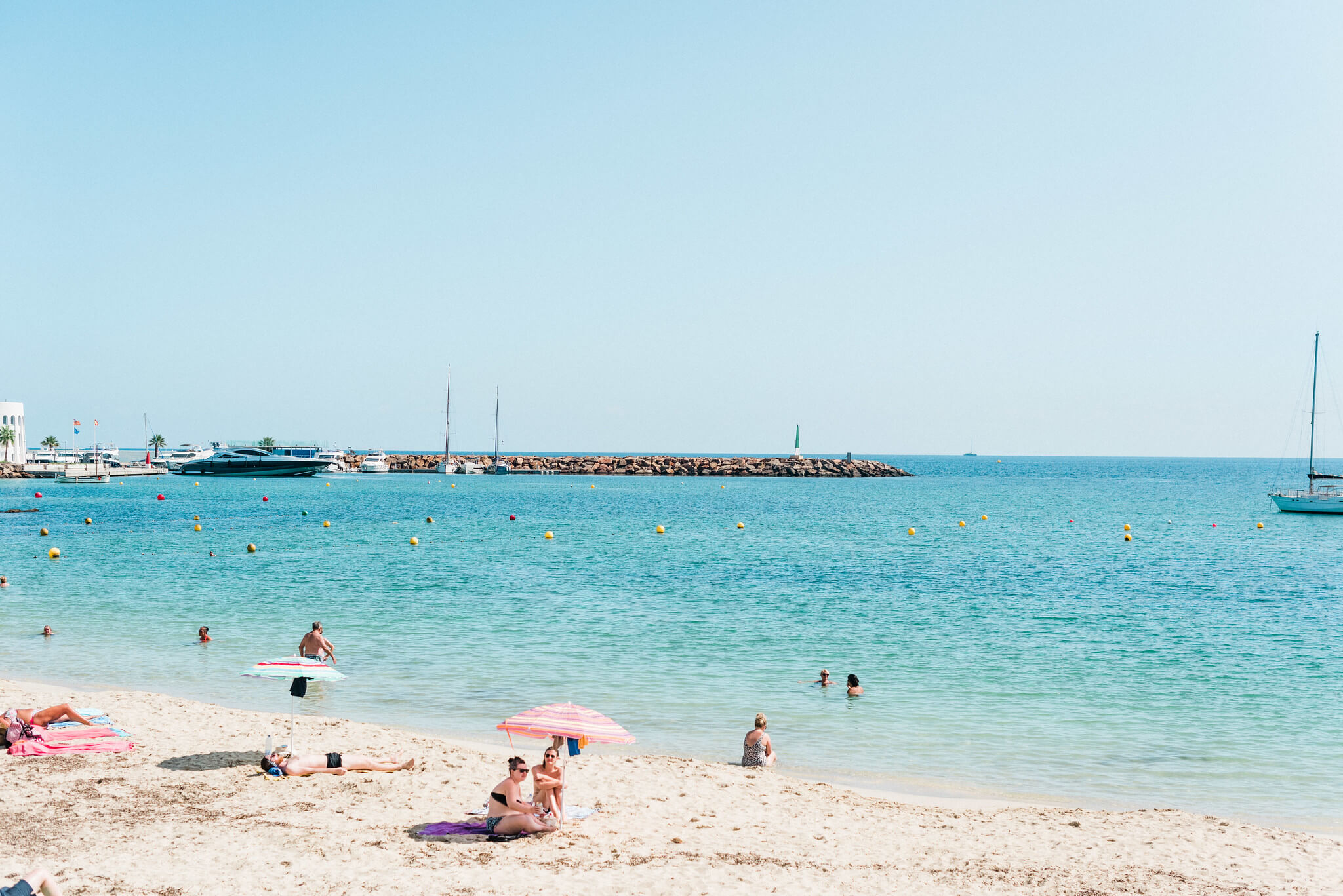 https://www.white-ibiza.com/wp-content/uploads/2020/03/ibiza-beaches-santa-eulalia-03.jpg