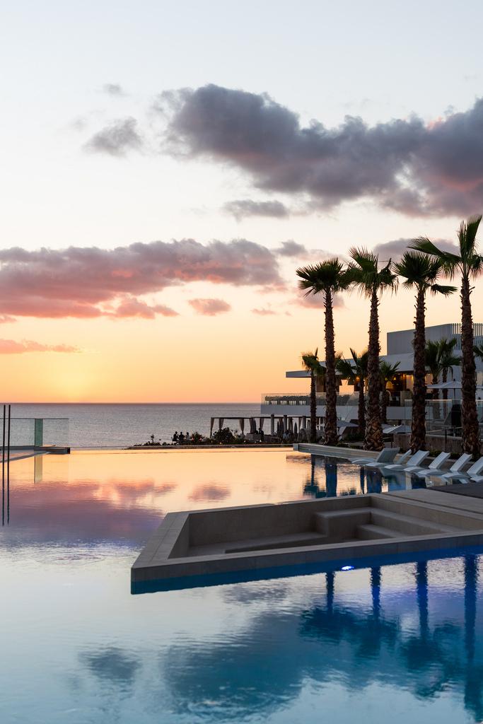 https://www.white-ibiza.com/wp-content/uploads/2020/03/ibiza-sunsets-seven-pines-resort-ibiza-2019-03.jpg