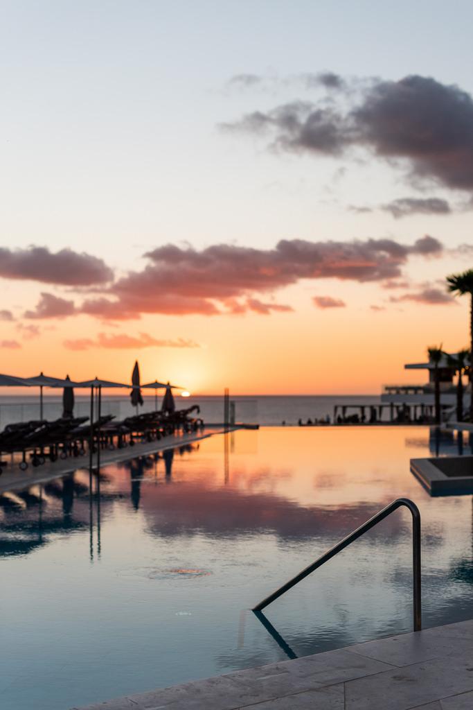 https://www.white-ibiza.com/wp-content/uploads/2020/03/ibiza-sunsets-seven-pines-resort-ibiza-2019-09.jpg
