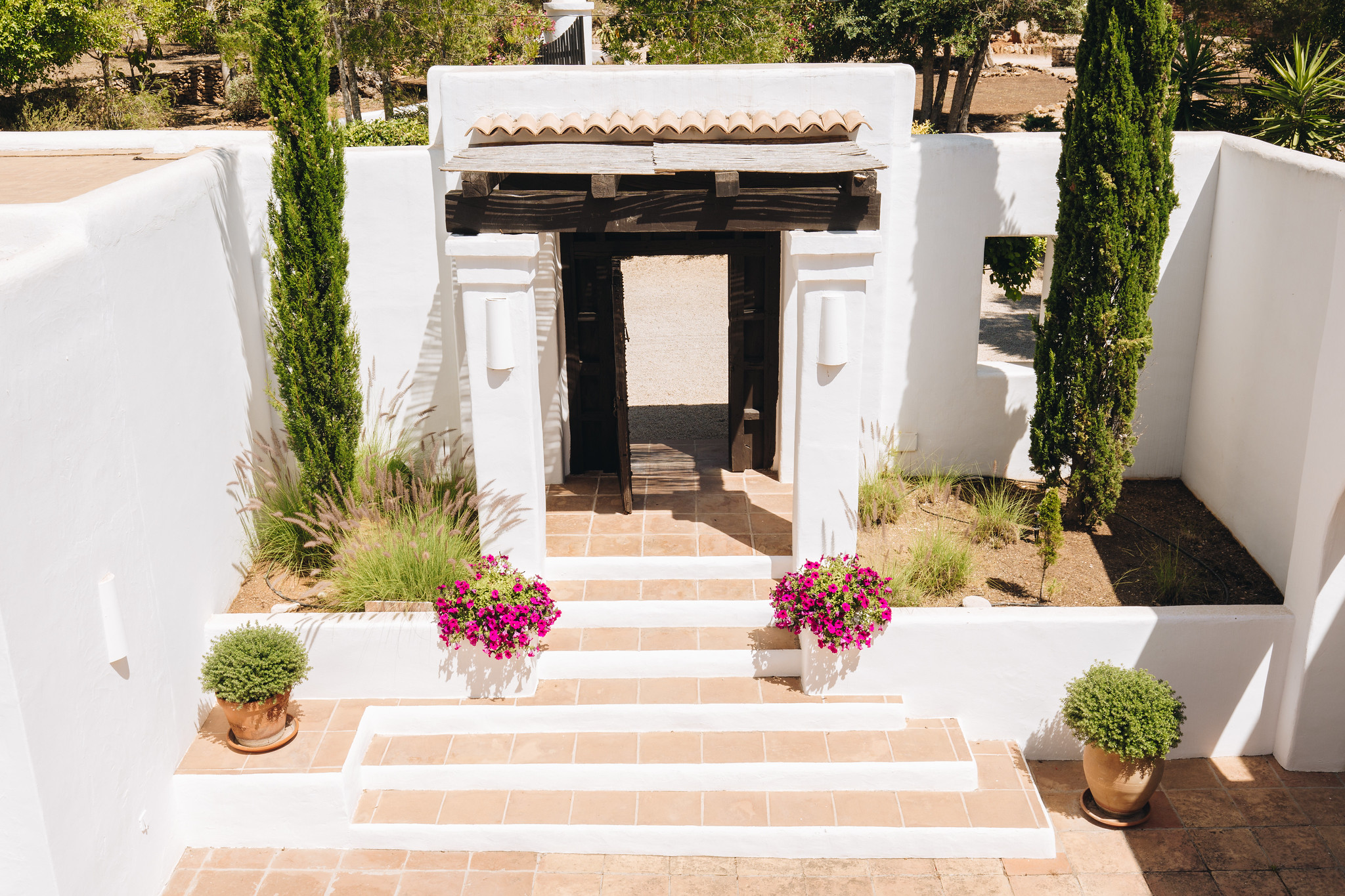 https://www.white-ibiza.com/wp-content/uploads/2020/05/white-ibiza-villas-can-amelida-exterior-steps.jpg
