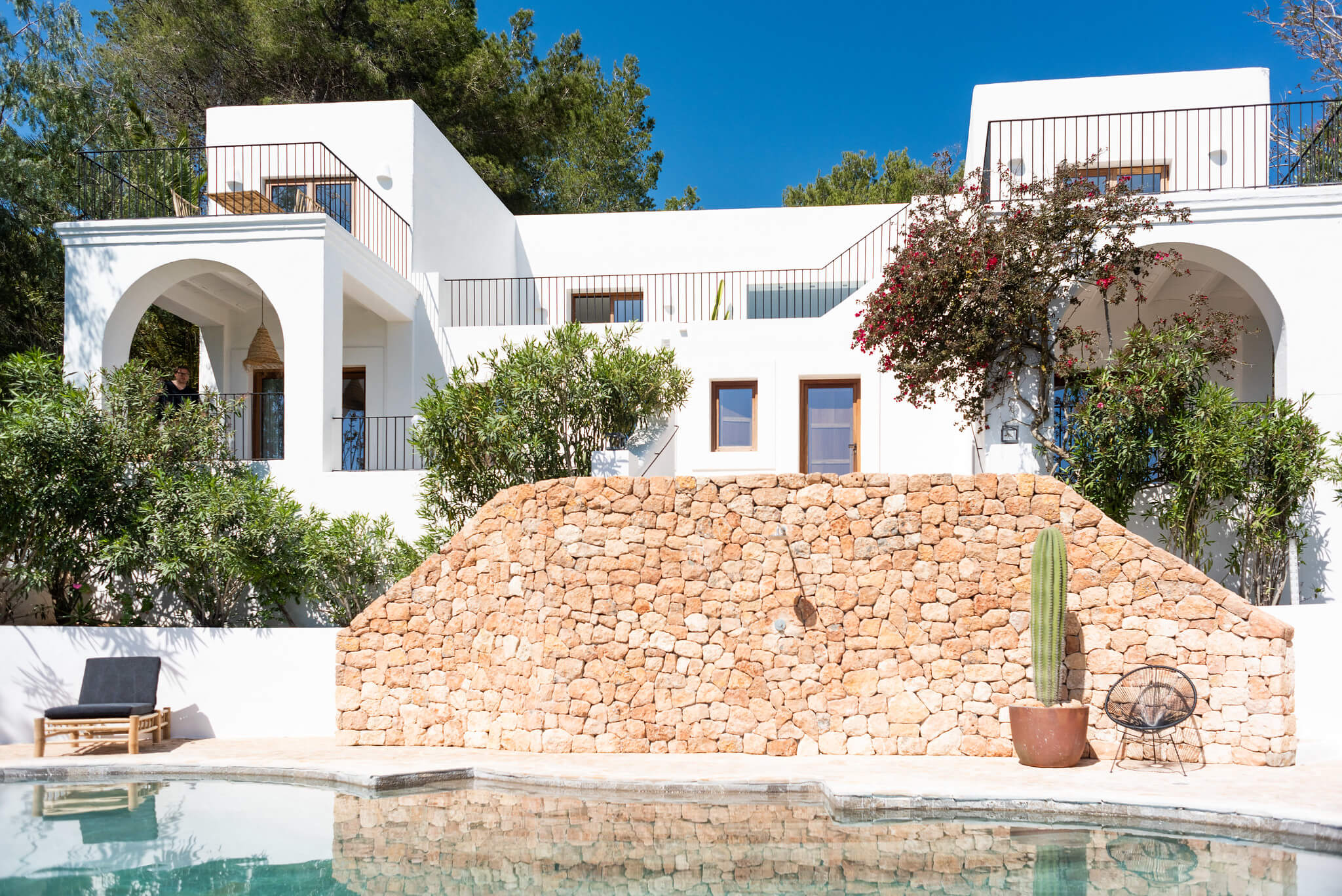 https://www.white-ibiza.com/wp-content/uploads/2020/05/white-ibiza-villas-can-cactus-view-from-pool.jpg
