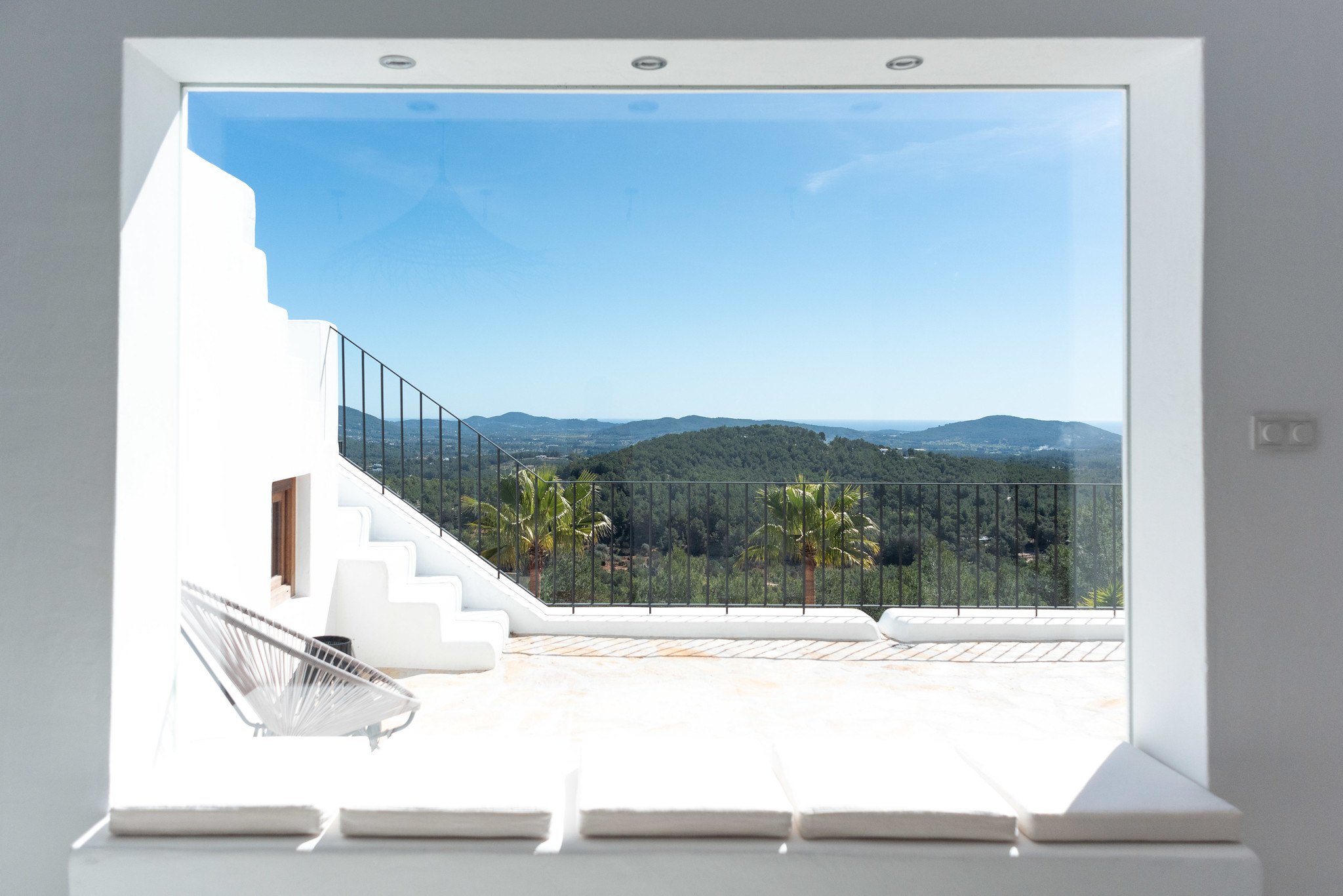 https://www.white-ibiza.com/wp-content/uploads/2020/05/white-ibiza-villas-can-cactus-window-view.jpg