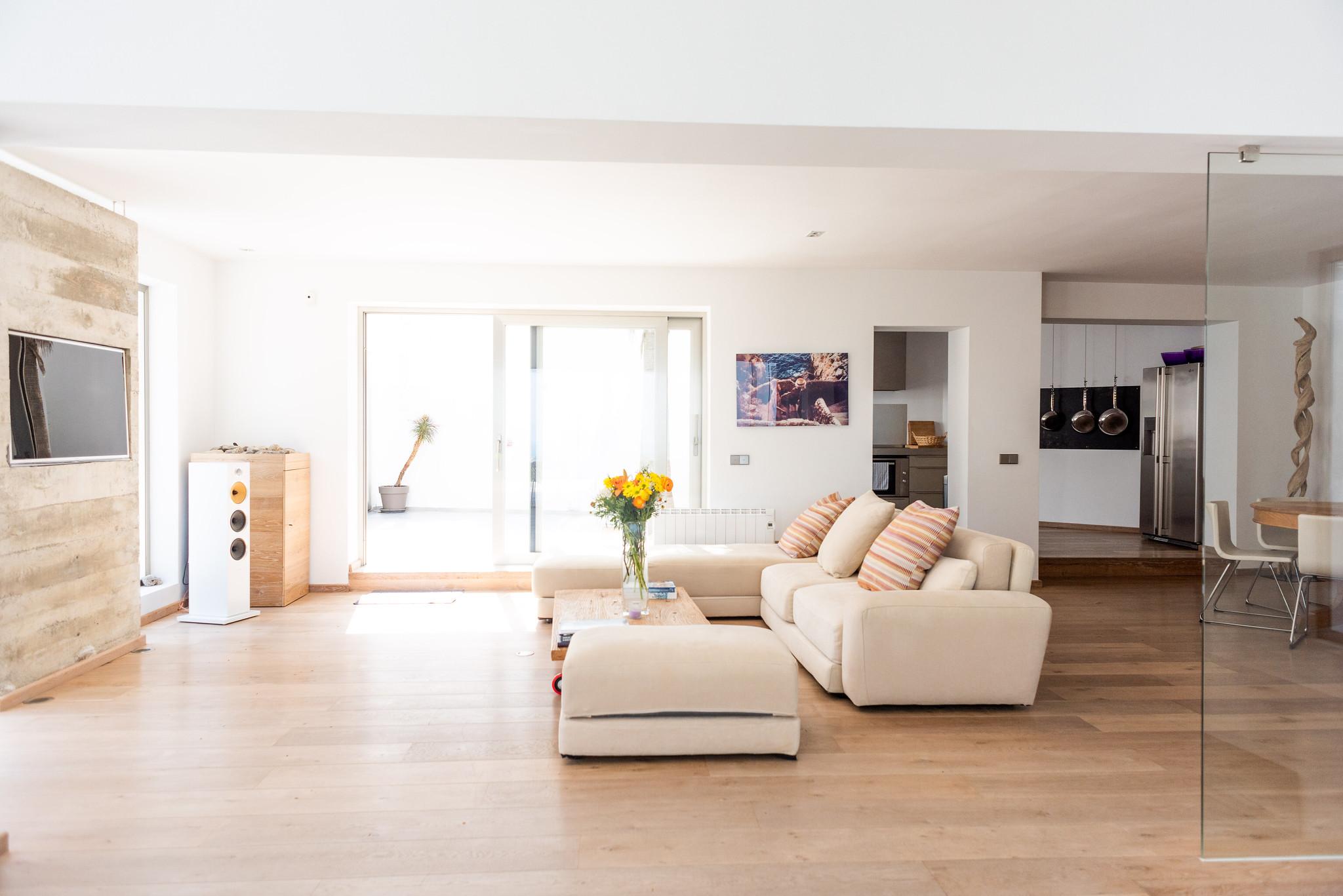 https://www.white-ibiza.com/wp-content/uploads/2020/05/white-ibiza-villas-can-dela-living-room-side-view.jpg