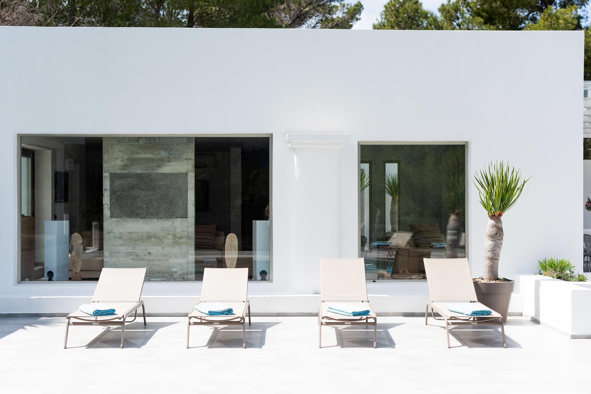 https://www.white-ibiza.com/wp-content/uploads/2020/05/white-ibiza-villas-can-dela-sun-loungers.jpg