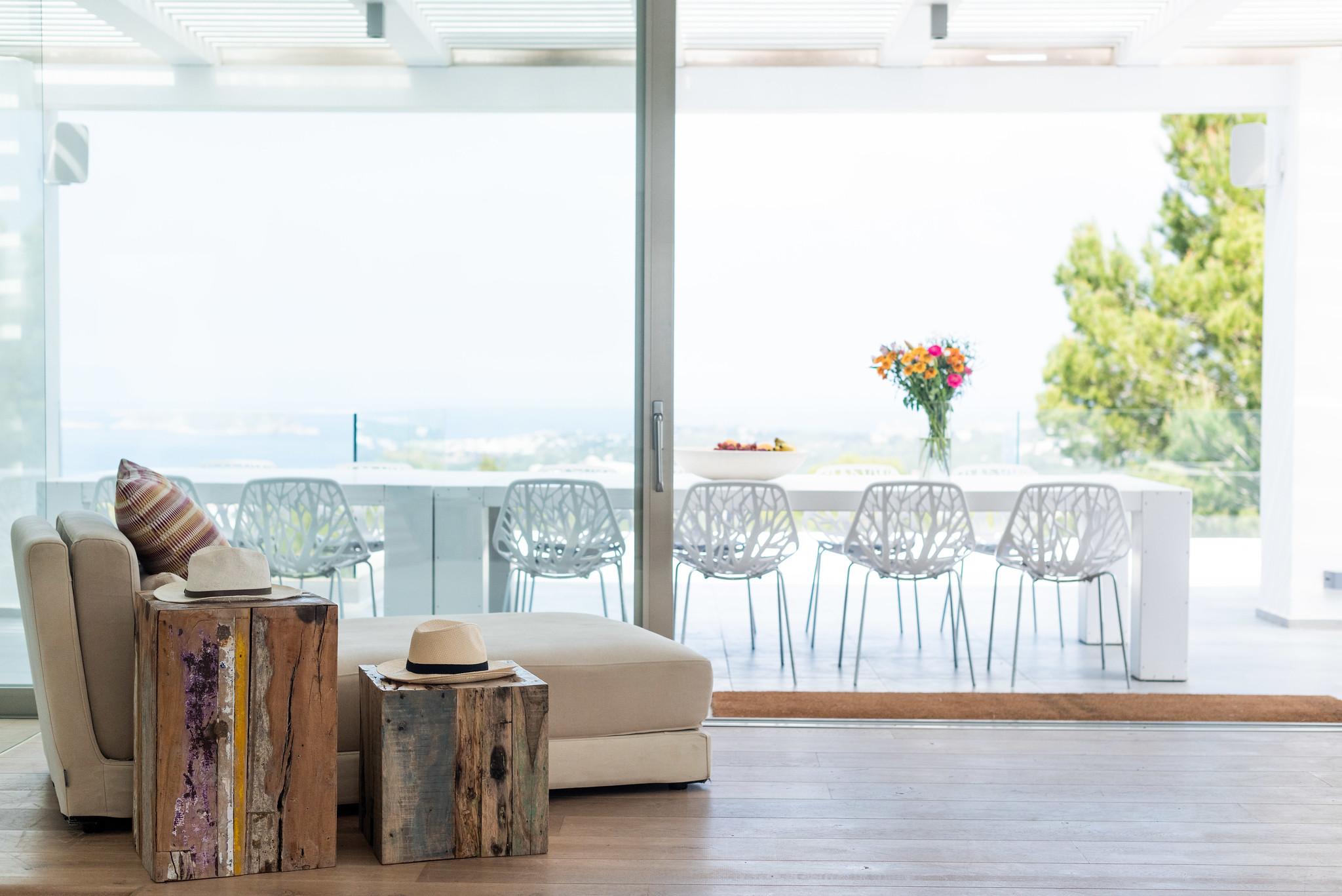 https://www.white-ibiza.com/wp-content/uploads/2020/05/white-ibiza-villas-can-dela-view-from-living-room.jpg