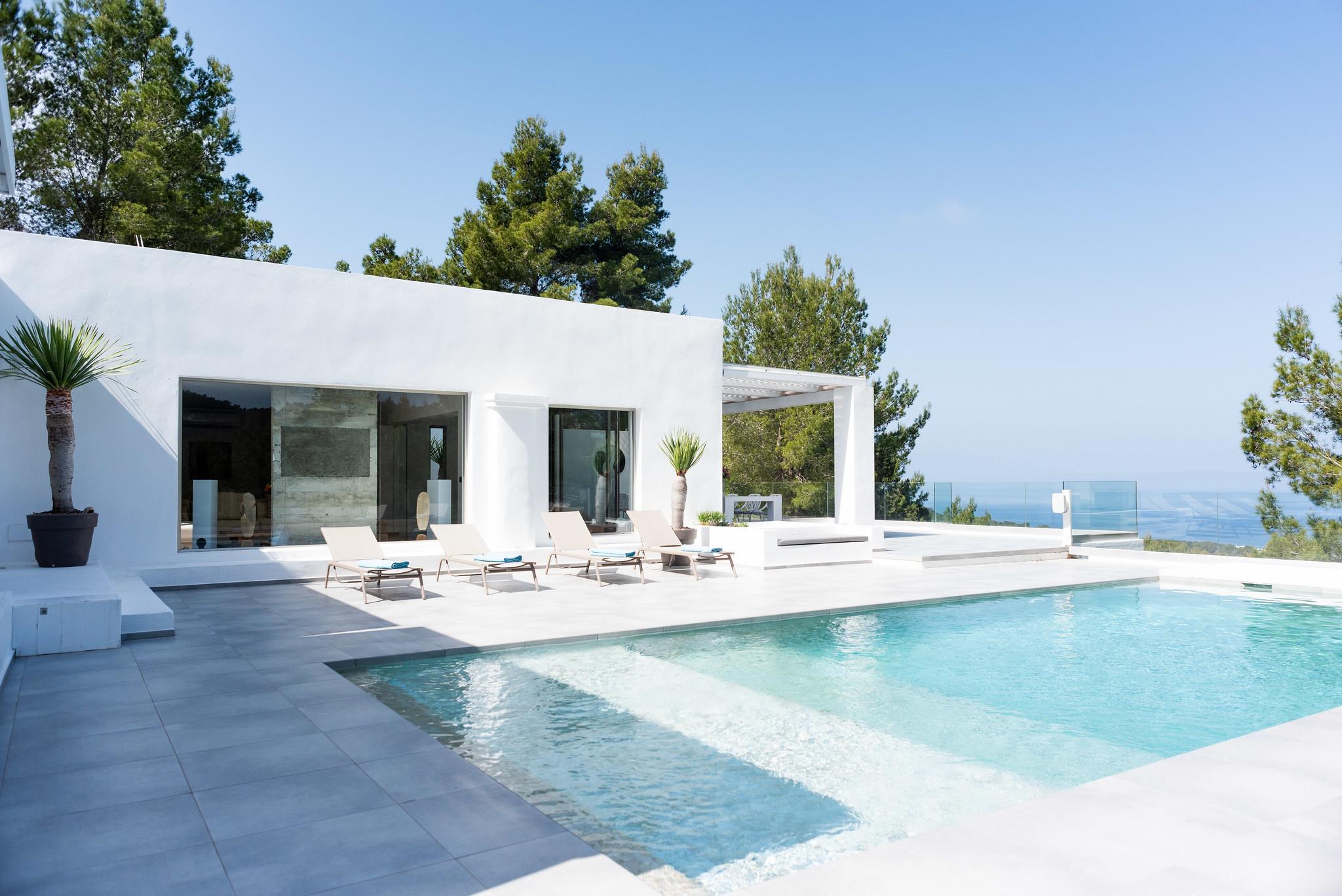 https://www.white-ibiza.com/wp-content/uploads/2020/05/white-ibiza-villas-can-dela-view-to-house.jpg