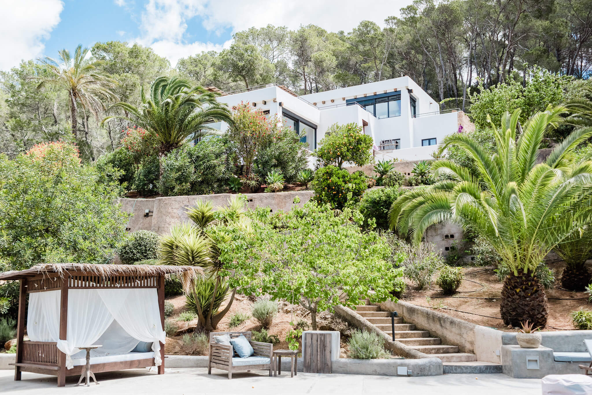 https://www.white-ibiza.com/wp-content/uploads/2020/05/white-ibiza-villas-can-iguana-exterior-from-pool.jpg