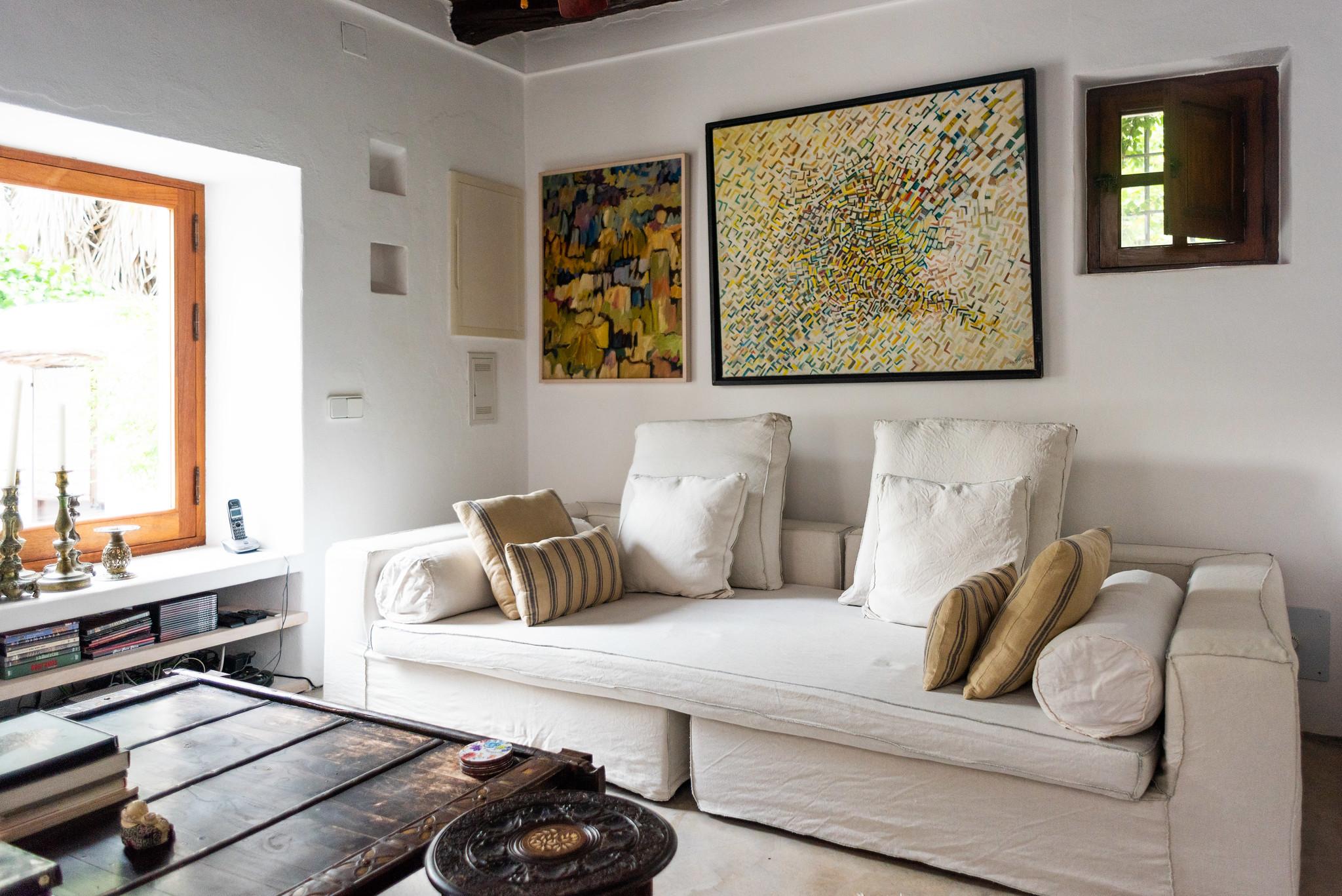 https://www.white-ibiza.com/wp-content/uploads/2020/05/white-ibiza-villas-can-lyra-interior-living-room-sofa.jpg