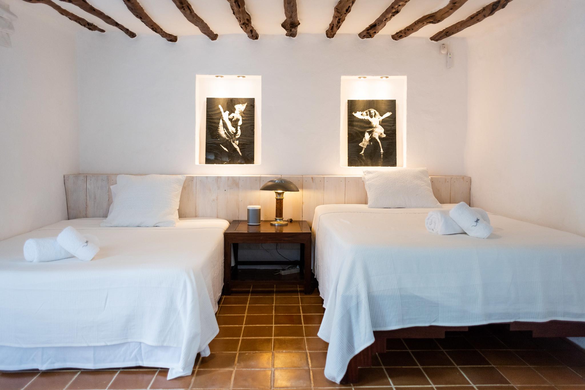 https://www.white-ibiza.com/wp-content/uploads/2020/05/white-ibiza-villas-can-lyra-twin-room.jpg