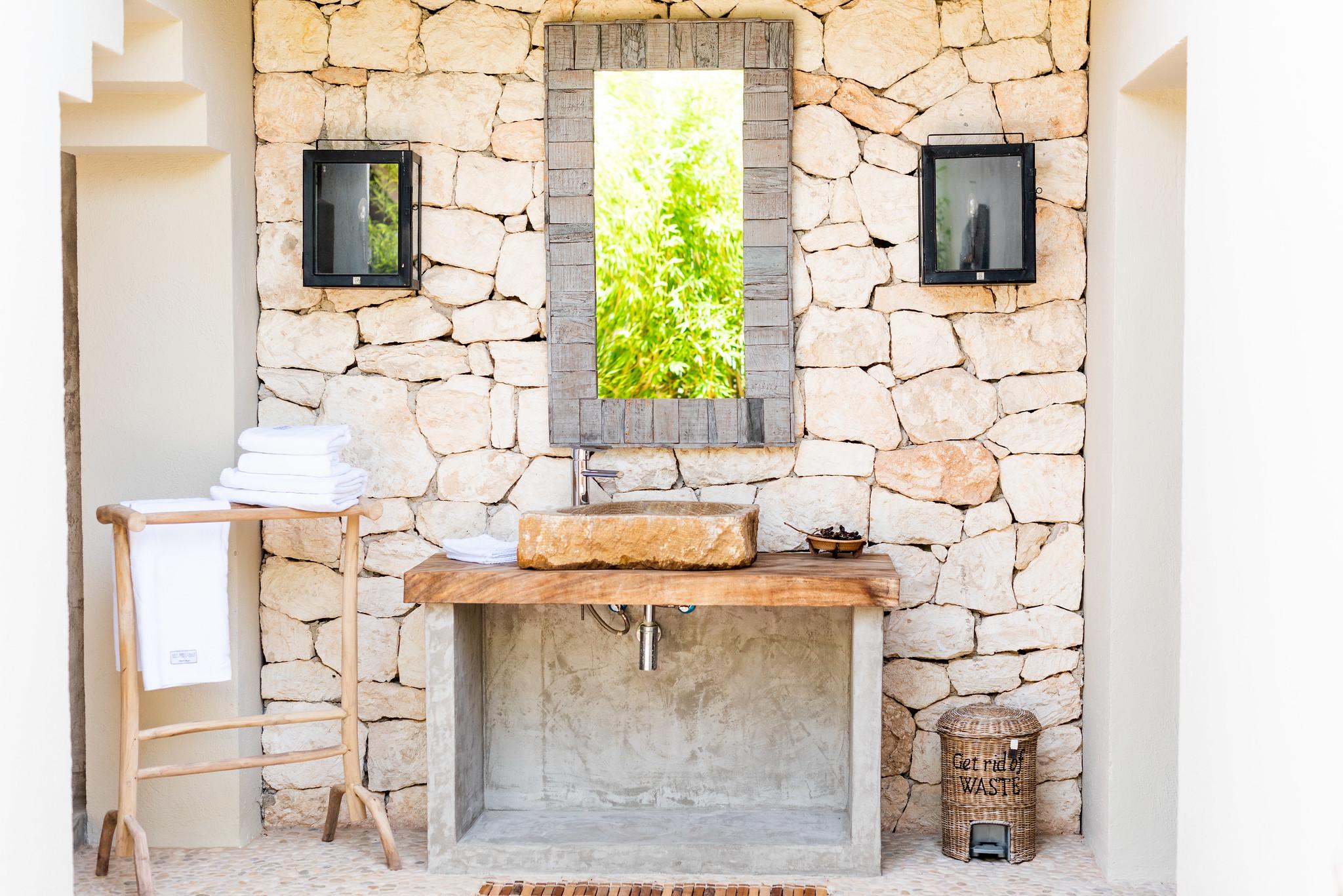 https://www.white-ibiza.com/wp-content/uploads/2020/05/white-ibiza-villas-can-riviere-exterior-outside-bathroom.jpg