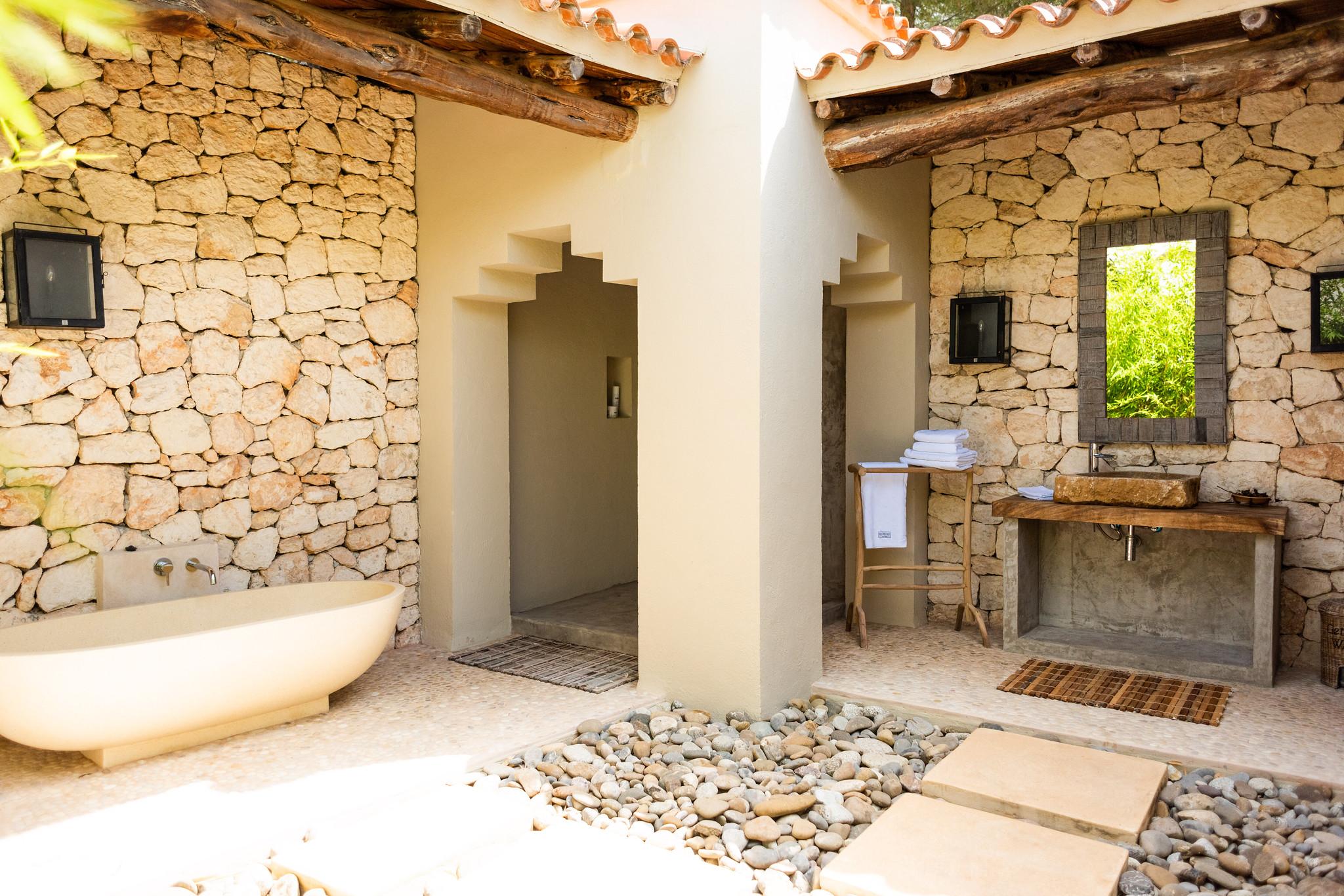 https://www.white-ibiza.com/wp-content/uploads/2020/05/white-ibiza-villas-can-riviere-exterior-outside-bathroom2.jpg