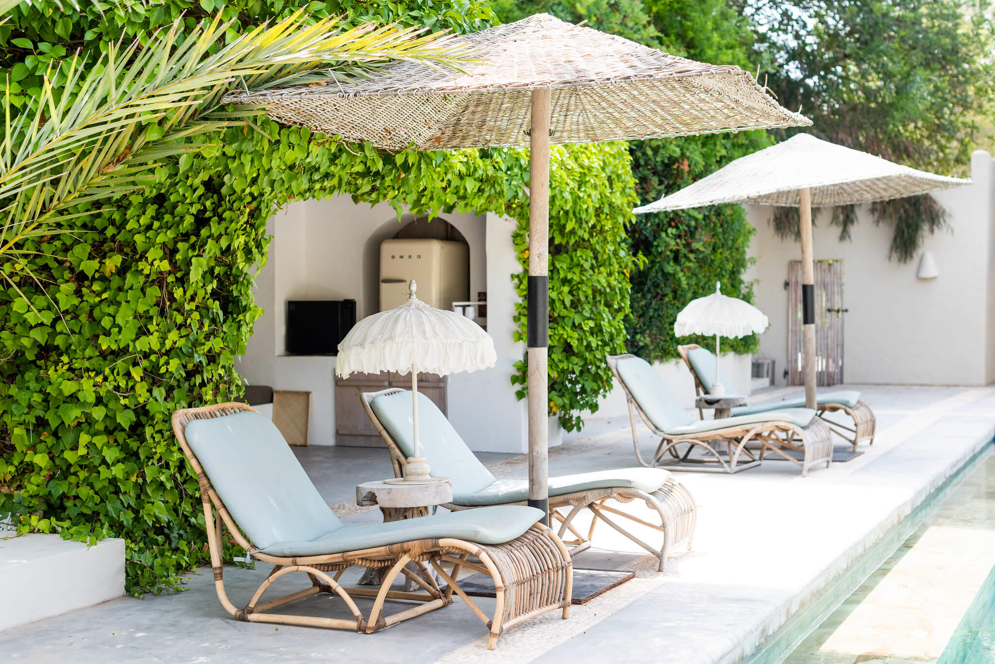 https://www.white-ibiza.com/wp-content/uploads/2020/05/white-ibiza-villas-can-riviere-exterior-rattan-loungers.jpg