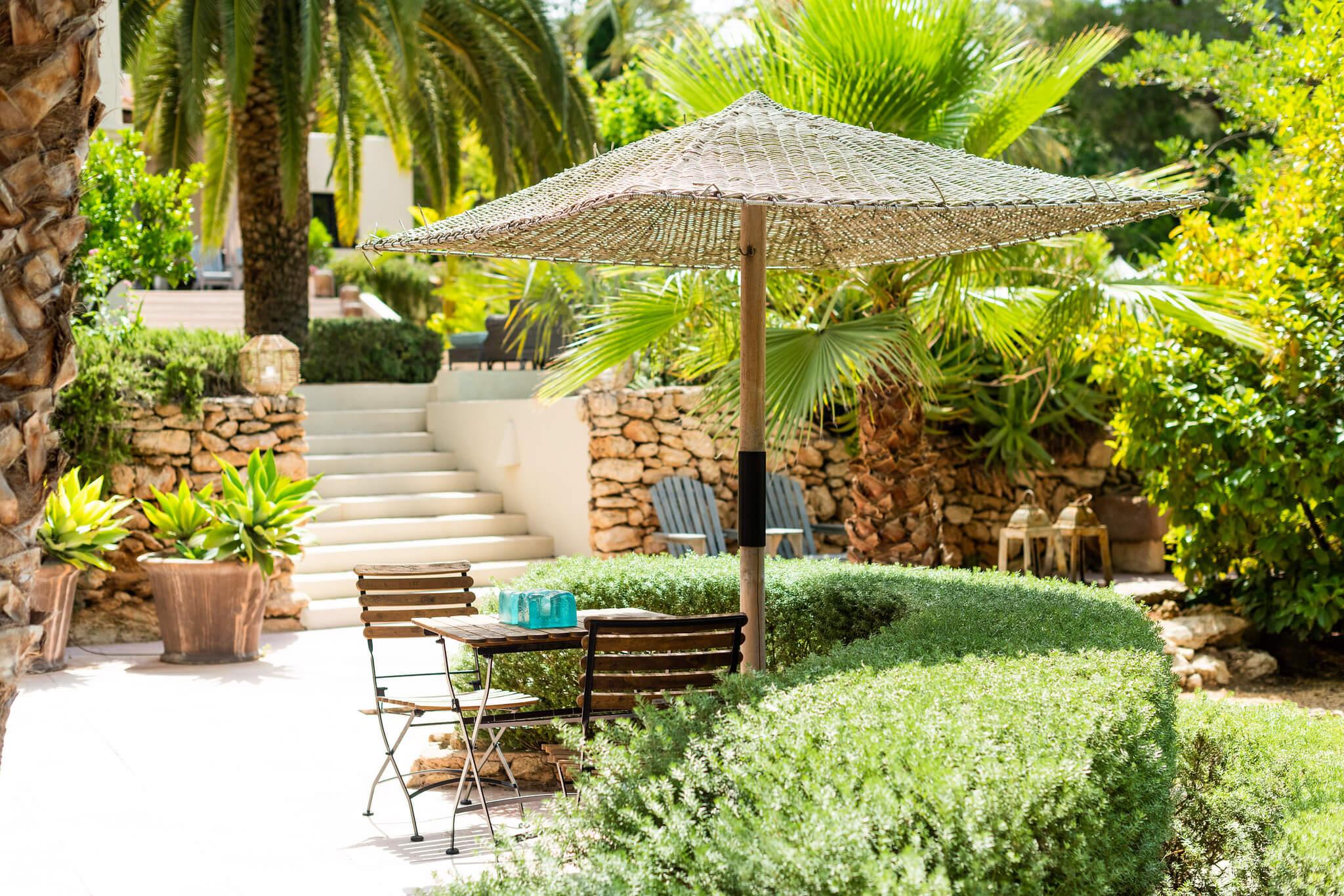https://www.white-ibiza.com/wp-content/uploads/2020/05/white-ibiza-villas-can-riviere-exterior-small-table.jpg