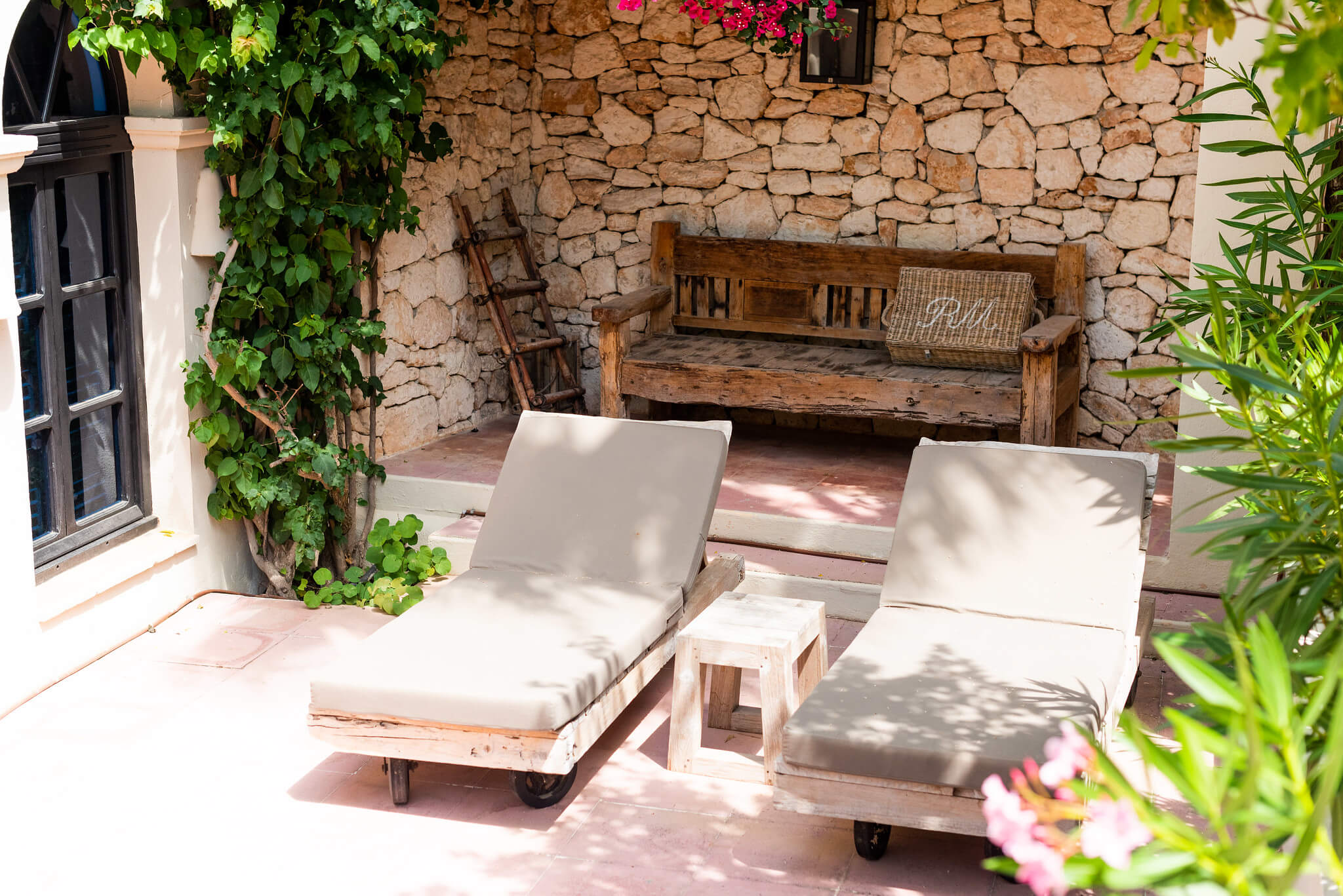 https://www.white-ibiza.com/wp-content/uploads/2020/05/white-ibiza-villas-can-riviere-exterior-sun-loungers-1.jpg