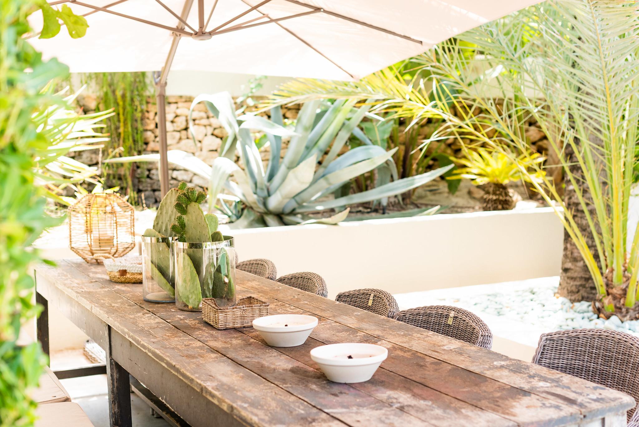 https://www.white-ibiza.com/wp-content/uploads/2020/05/white-ibiza-villas-can-riviere-exterior-table.jpg