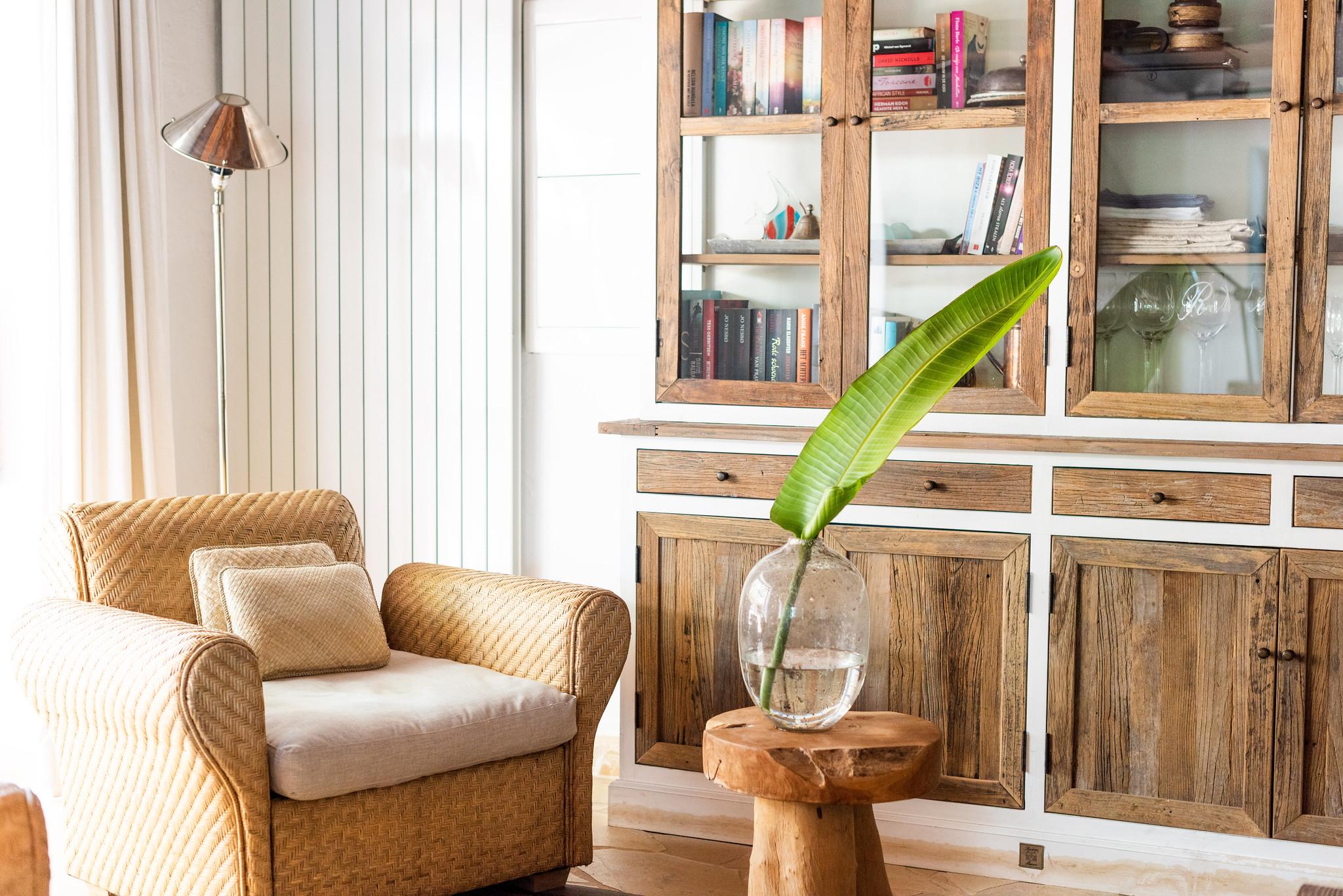 https://www.white-ibiza.com/wp-content/uploads/2020/05/white-ibiza-villas-can-riviere-interior-rattan-armchair.jpg