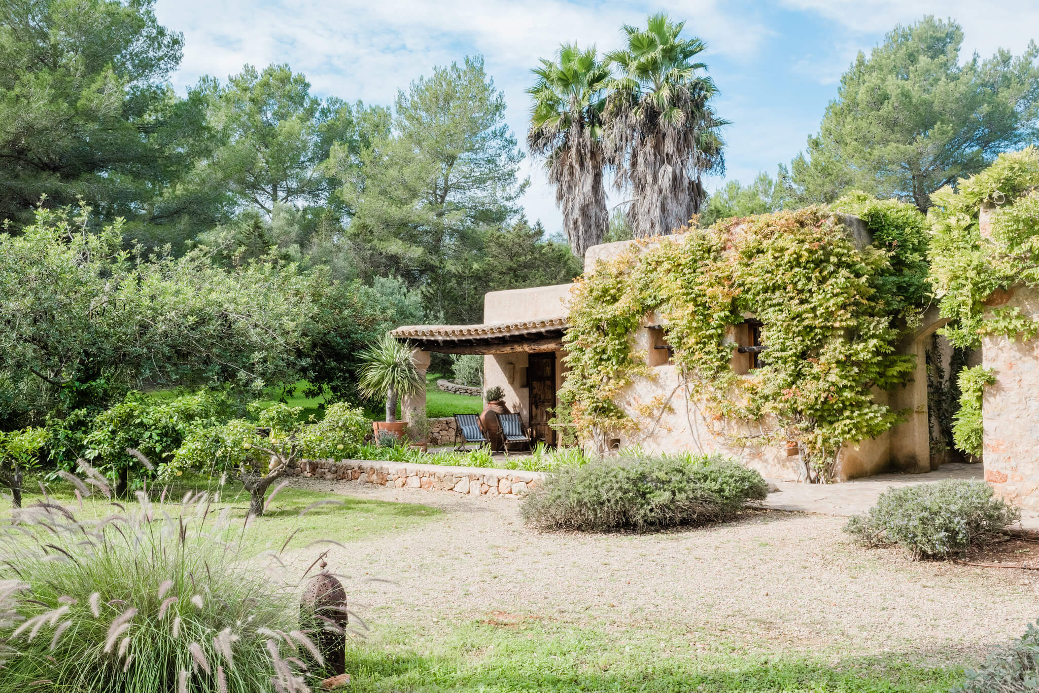 https://www.white-ibiza.com/wp-content/uploads/2020/05/white-ibiza-villas-can-sabina-exterior-building.jpg