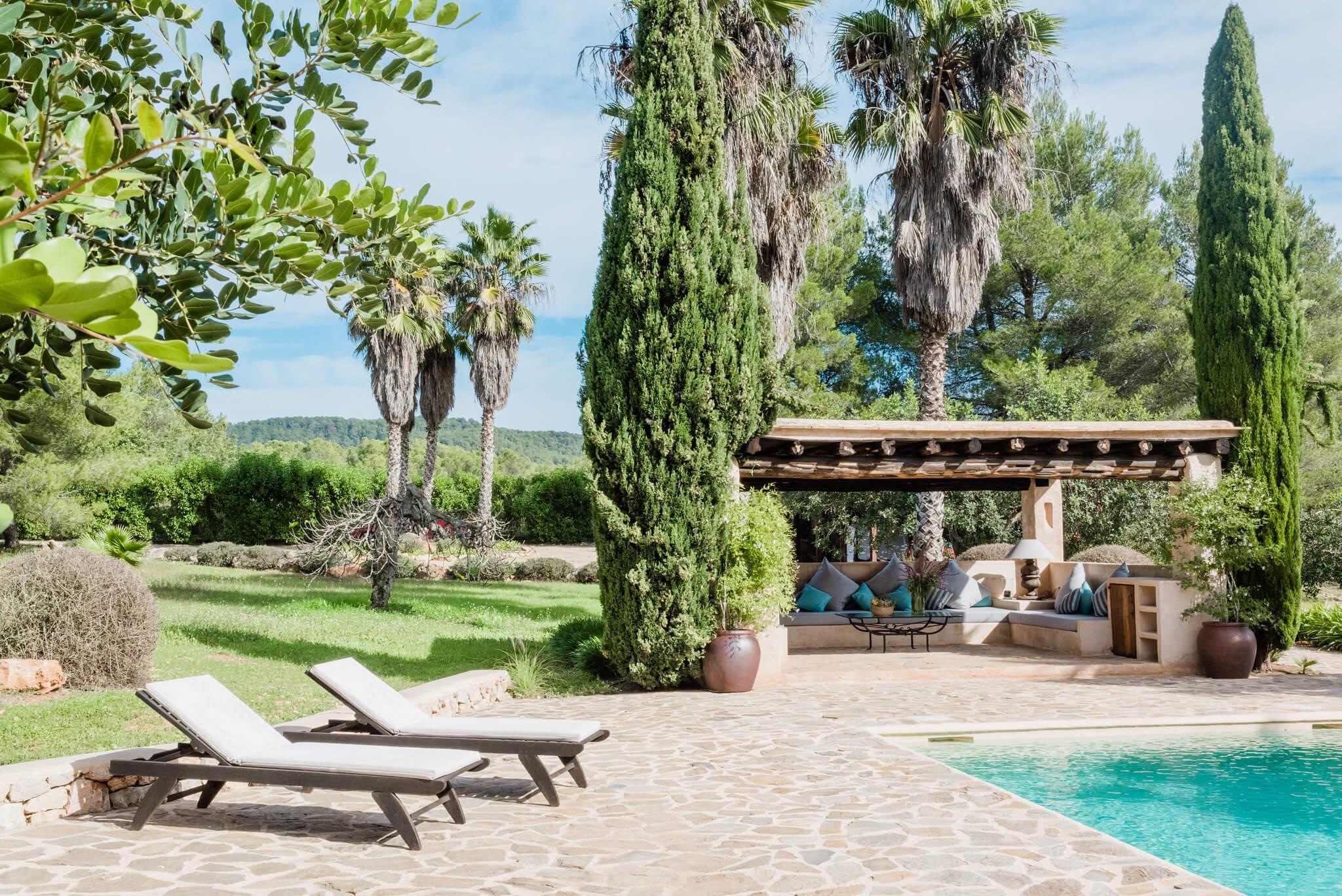 https://www.white-ibiza.com/wp-content/uploads/2020/05/white-ibiza-villas-can-sabina-exterior-pool-scene.jpg