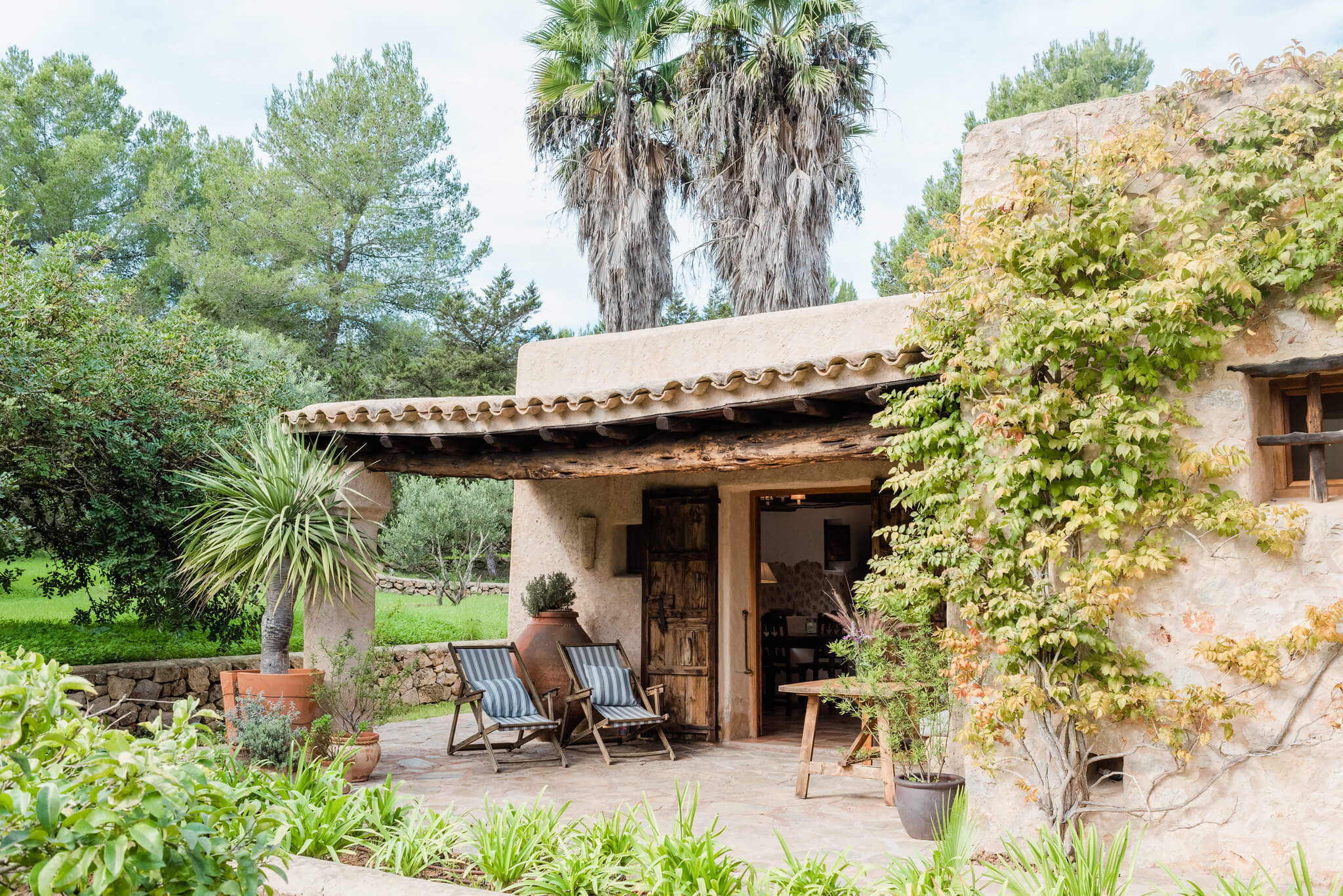https://www.white-ibiza.com/wp-content/uploads/2020/05/white-ibiza-villas-can-sabina-exterior-terrace.jpg