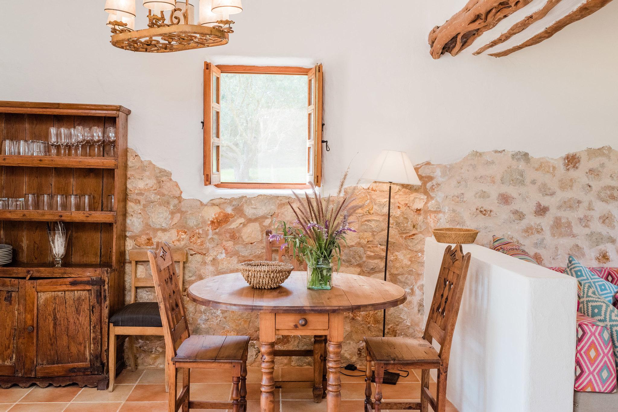 https://www.white-ibiza.com/wp-content/uploads/2020/05/white-ibiza-villas-can-sabina-interior-table.jpg