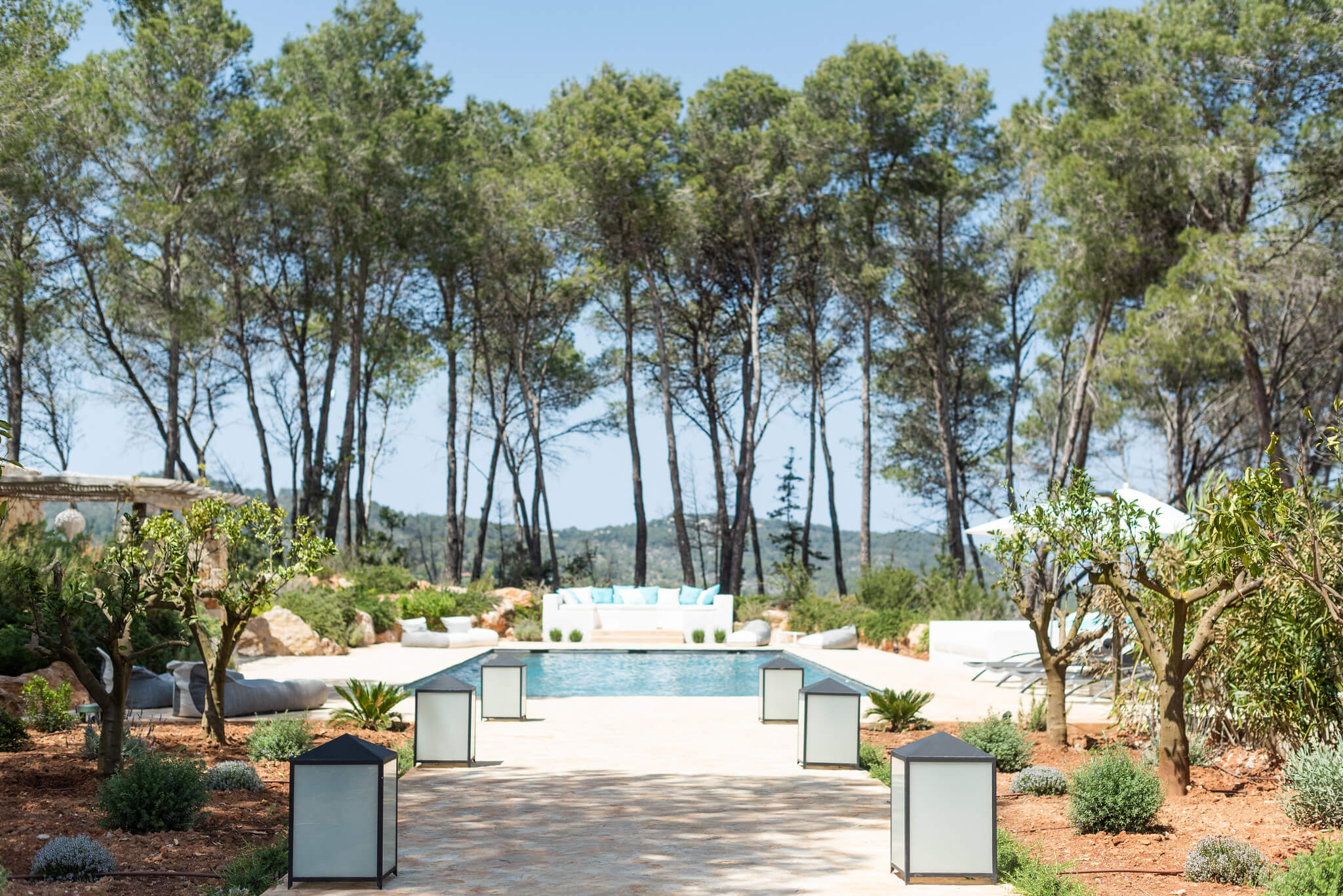 https://www.white-ibiza.com/wp-content/uploads/2020/05/white-ibiza-villas-can-terra-surrounded-by-forest.jpg