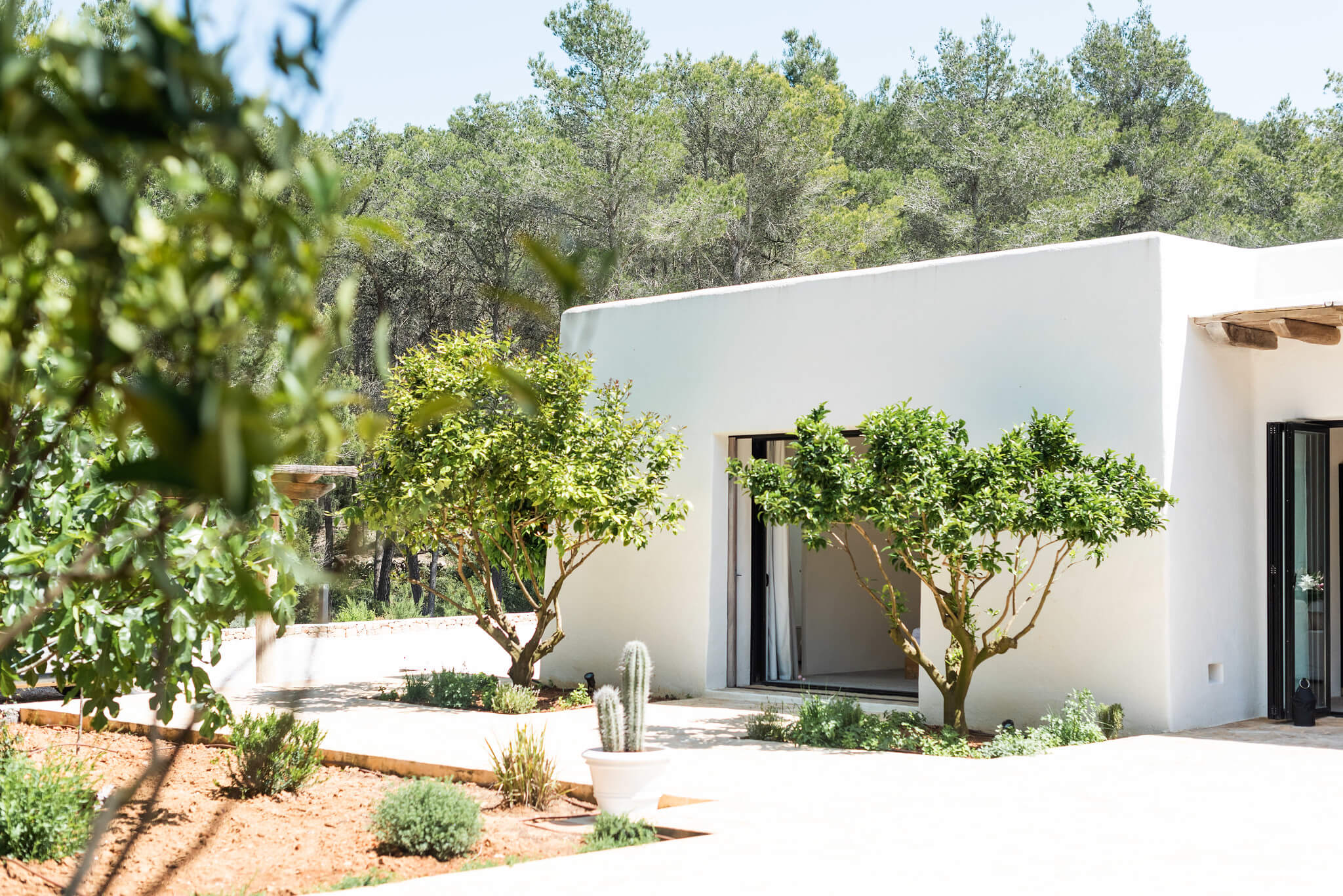 https://www.white-ibiza.com/wp-content/uploads/2020/05/white-ibiza-villas-can-terra-view-to-bedroom.jpg
