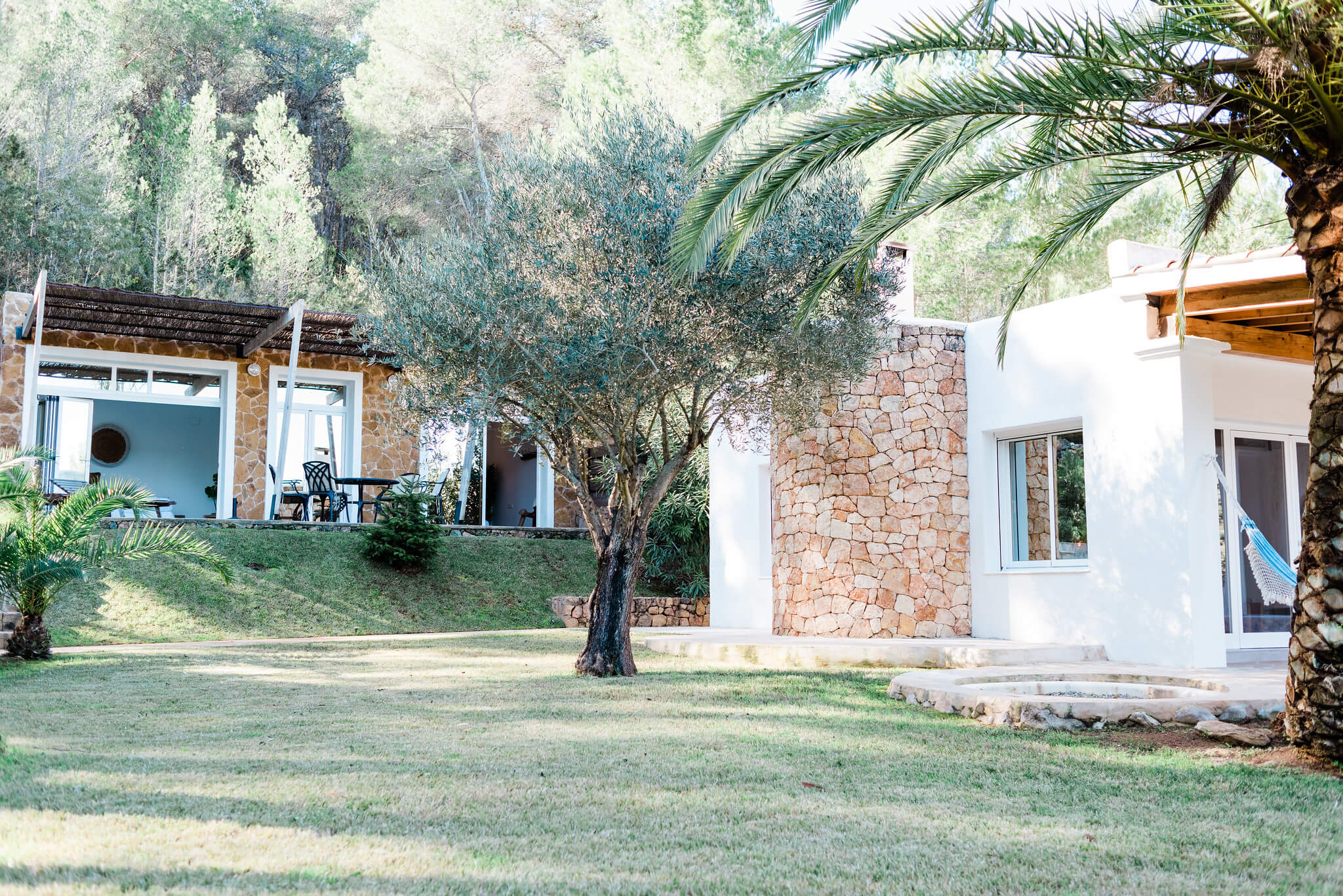 https://www.white-ibiza.com/wp-content/uploads/2020/05/white-ibiza-villas-can-verde-exterior-garden-views.jpg