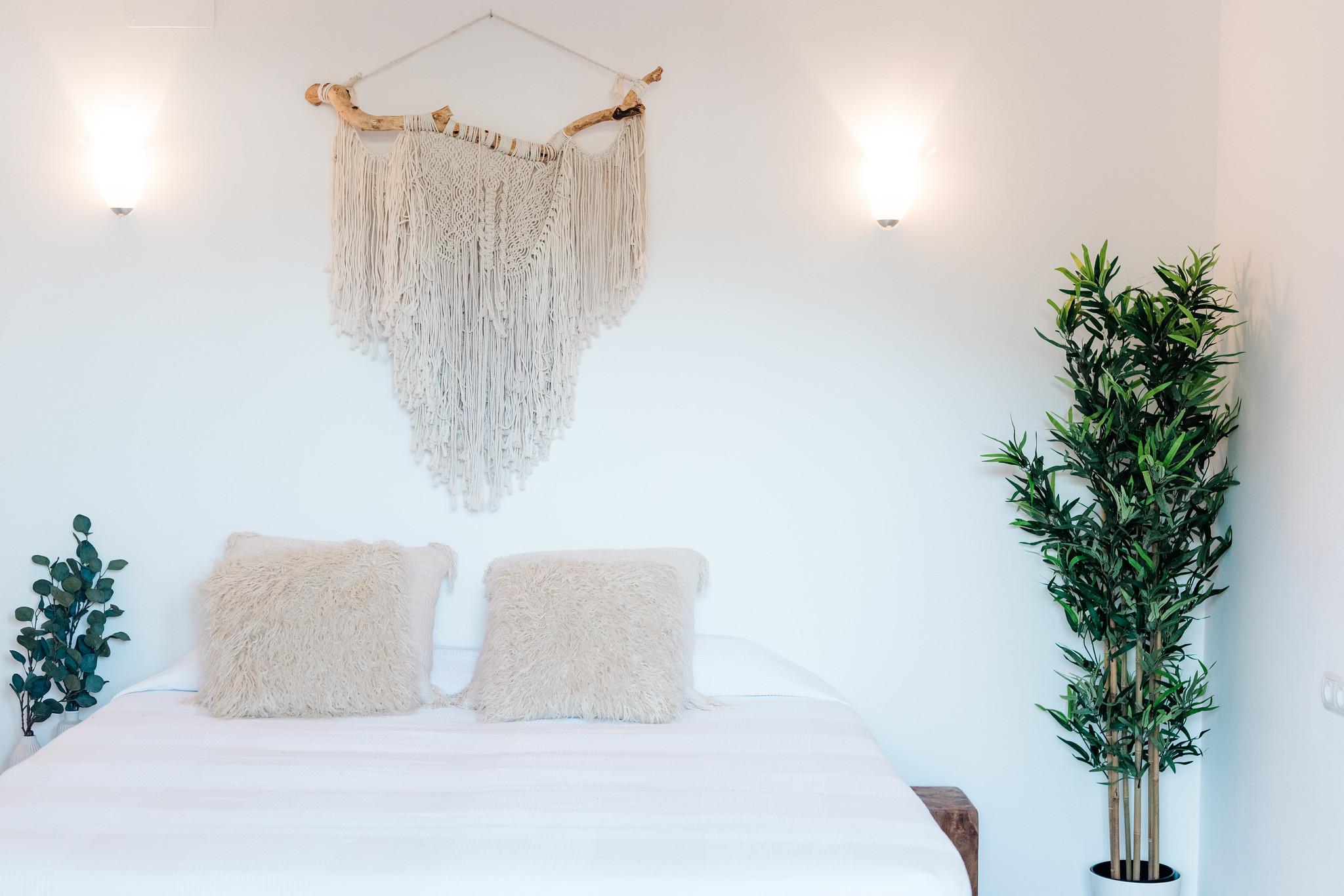 https://www.white-ibiza.com/wp-content/uploads/2020/05/white-ibiza-villas-can-verde-interior-wall-hanging.jpg