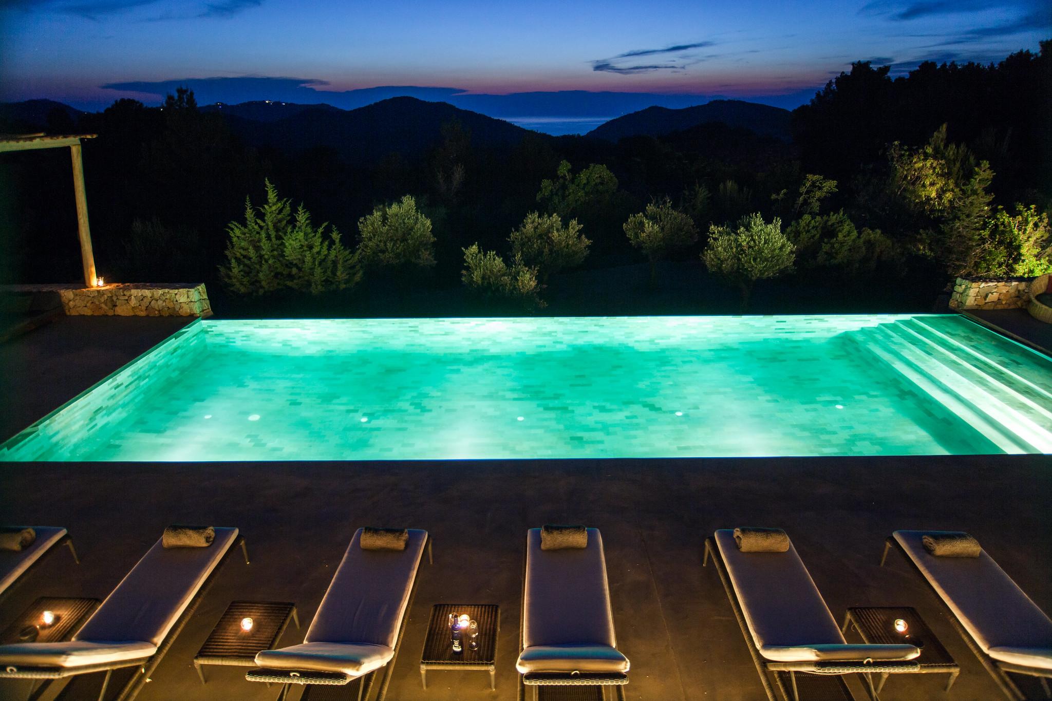 https://www.white-ibiza.com/wp-content/uploads/2020/05/white-ibiza-villas-can-zama-pool-at-night-view.jpg