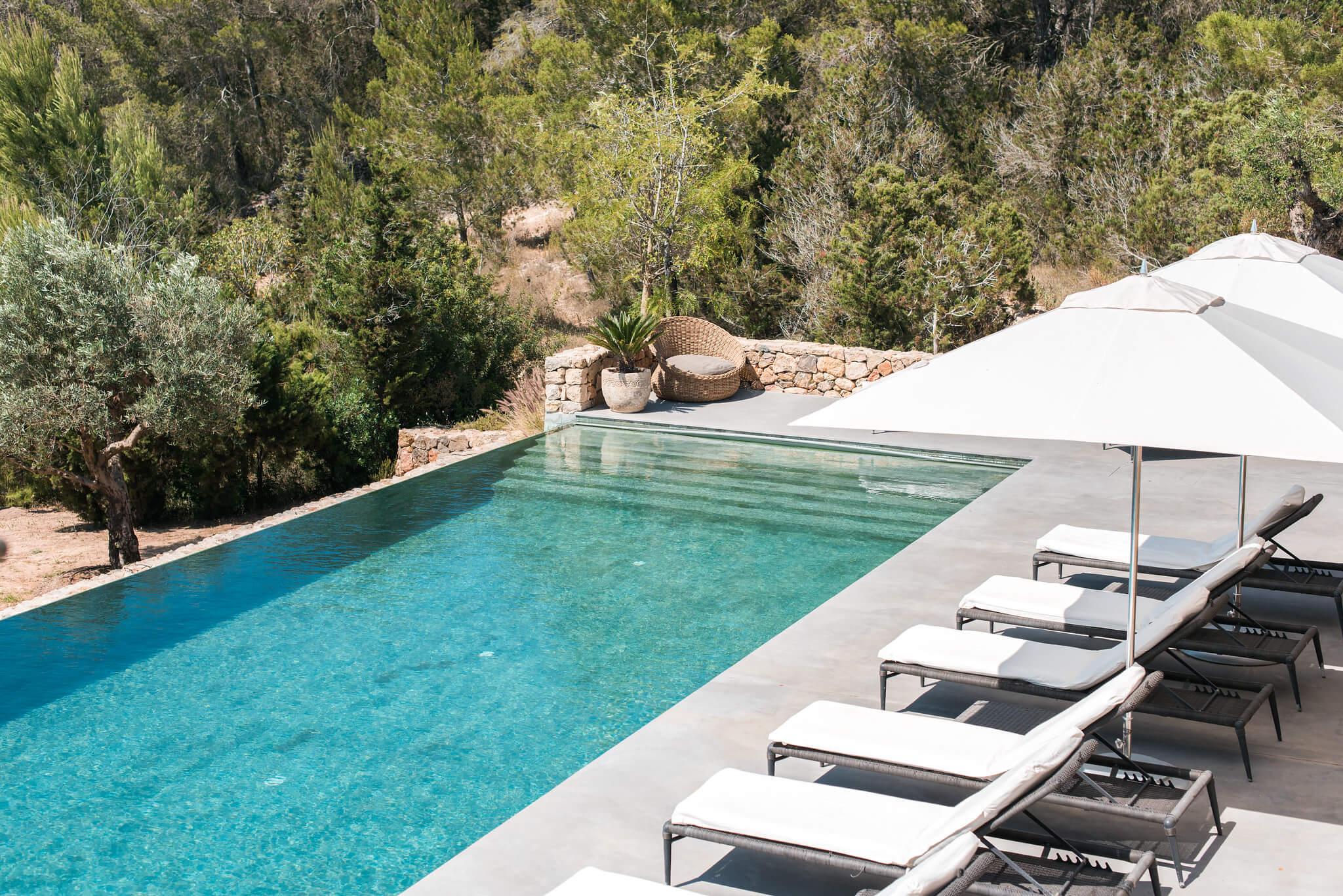 https://www.white-ibiza.com/wp-content/uploads/2020/05/white-ibiza-villas-can-zama-pool-from-lawn-copy.jpg