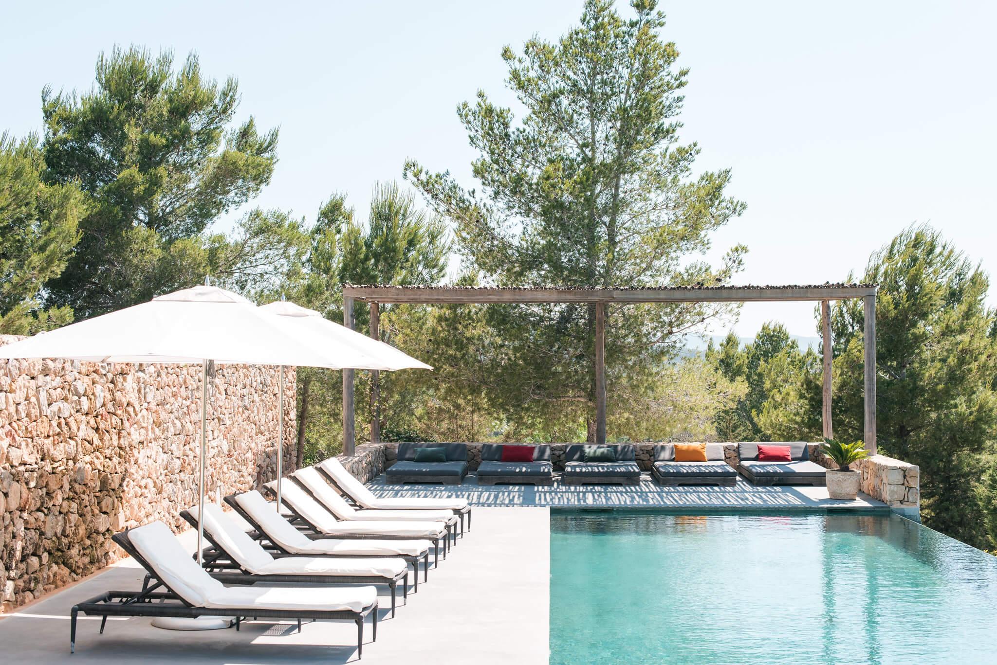https://www.white-ibiza.com/wp-content/uploads/2020/05/white-ibiza-villas-can-zama-pool-loungers-copy.jpg