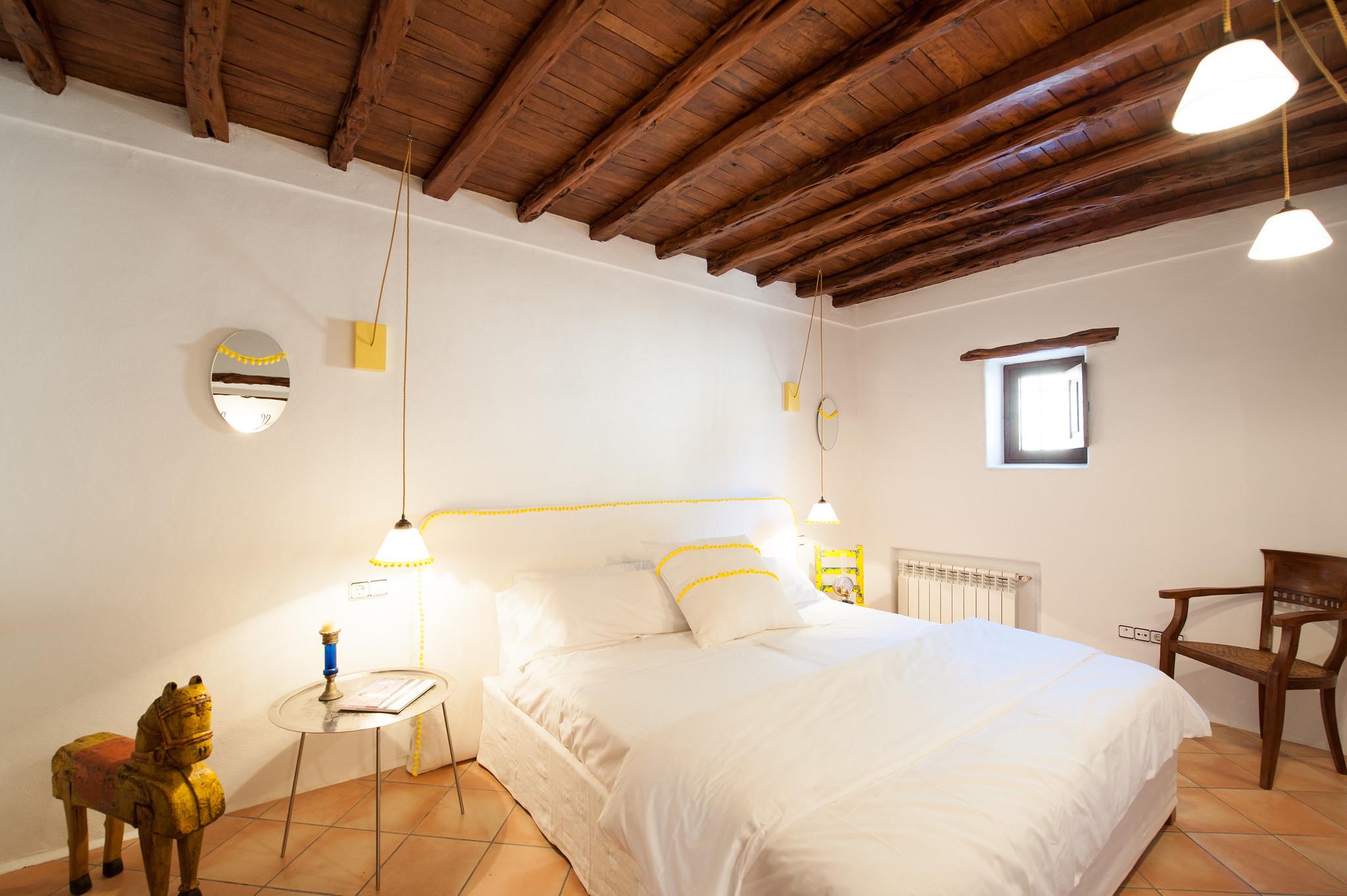 https://www.white-ibiza.com/wp-content/uploads/2020/06/white-ibiza-villas-can-blay-interior-bedroom.jpg