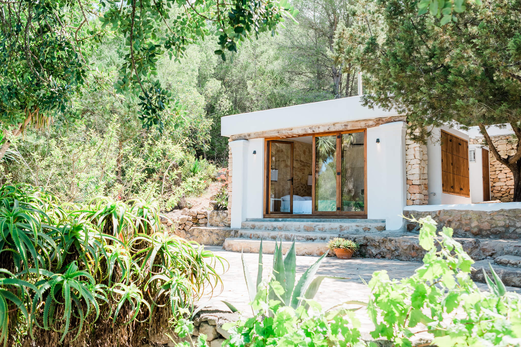 https://www.white-ibiza.com/wp-content/uploads/2020/06/white-ibiza-villas-can-calma-exterior-annex.jpg