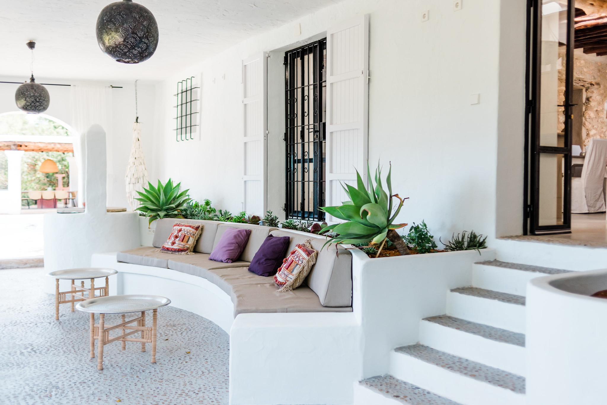 https://www.white-ibiza.com/wp-content/uploads/2020/06/white-ibiza-villas-can-calma-exterior-outside-seating2.jpg