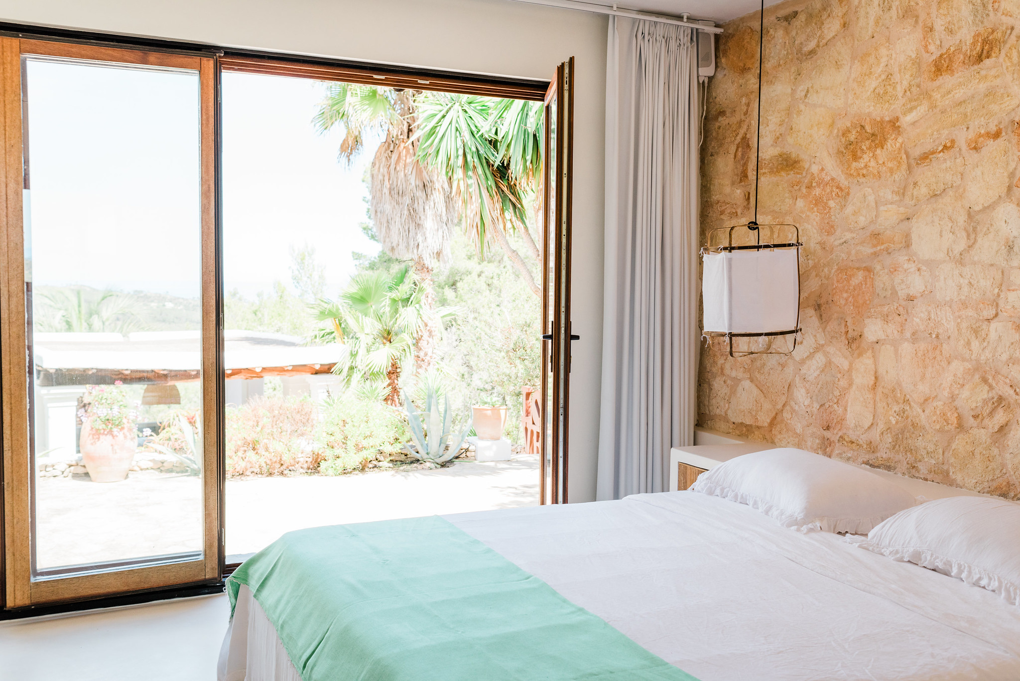 https://www.white-ibiza.com/wp-content/uploads/2020/06/white-ibiza-villas-can-calma-interior-bedroom5.jpg