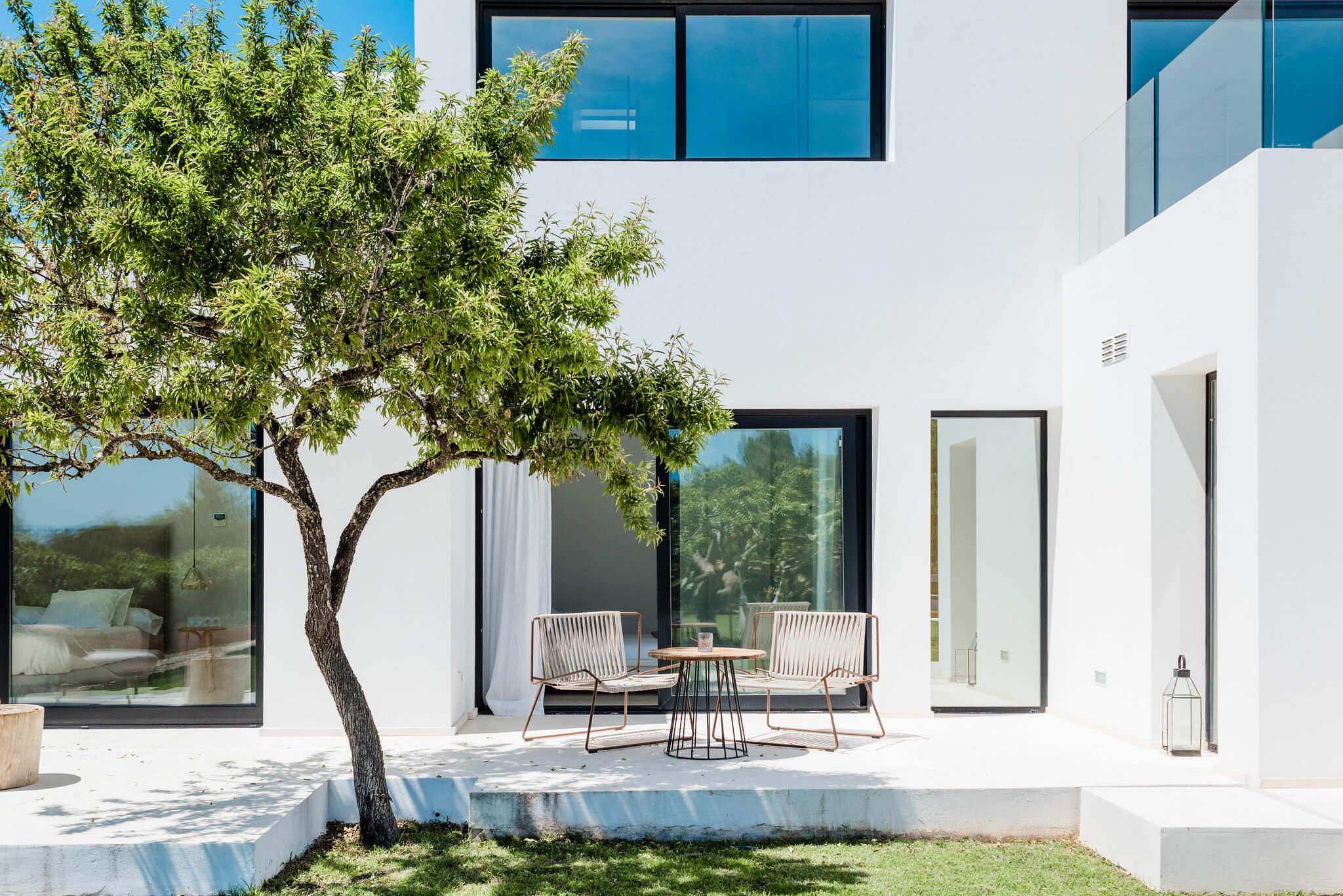 https://www.white-ibiza.com/wp-content/uploads/2020/06/white-ibiza-villas-can-carmen-exterior-another-seatingarea.jpg