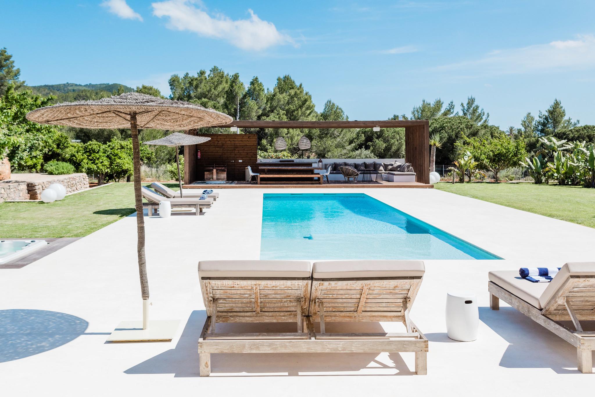 https://www.white-ibiza.com/wp-content/uploads/2020/06/white-ibiza-villas-can-carmen-exterior-from-lounger.jpg