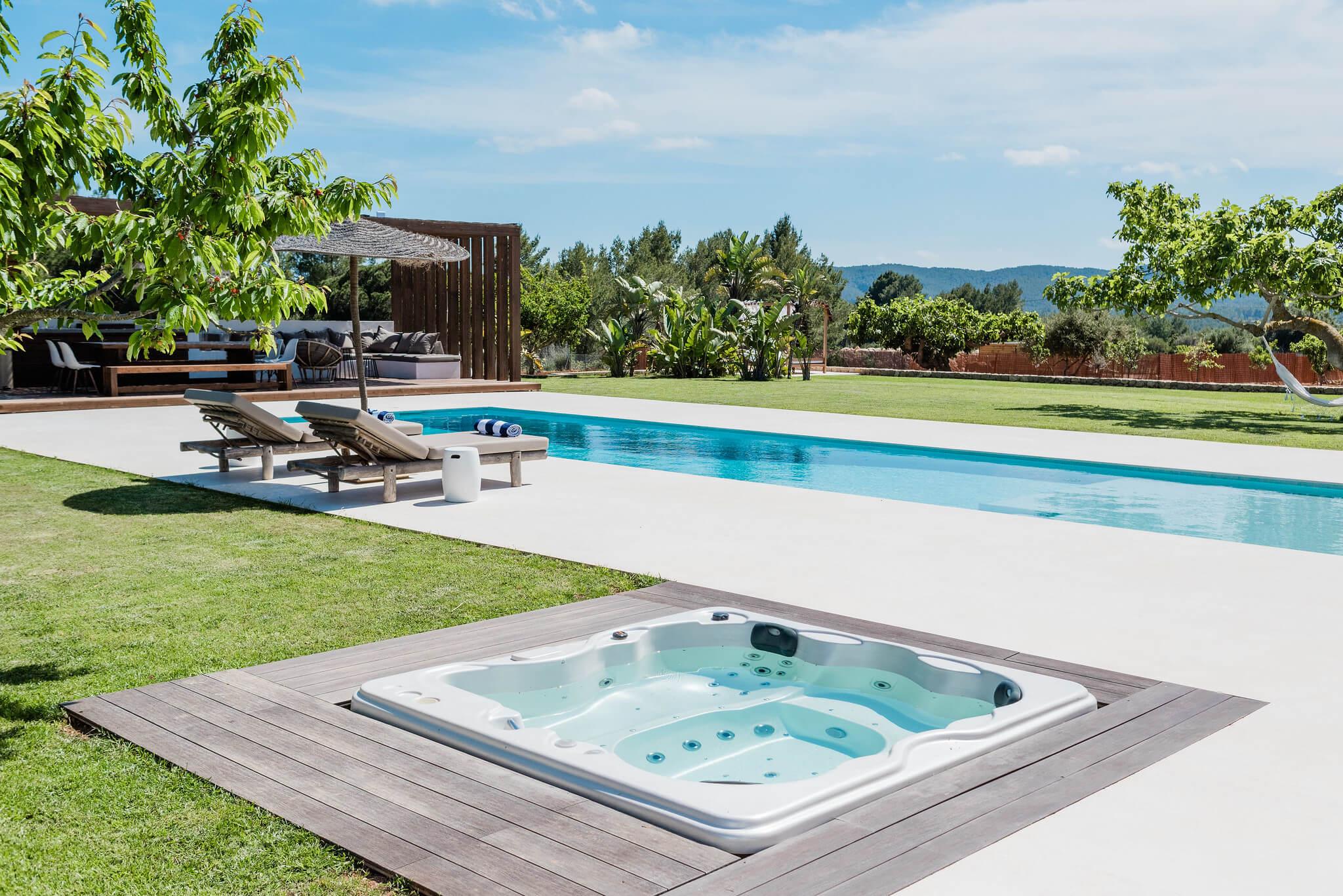 https://www.white-ibiza.com/wp-content/uploads/2020/06/white-ibiza-villas-can-carmen-exterior-hot-tub.jpg