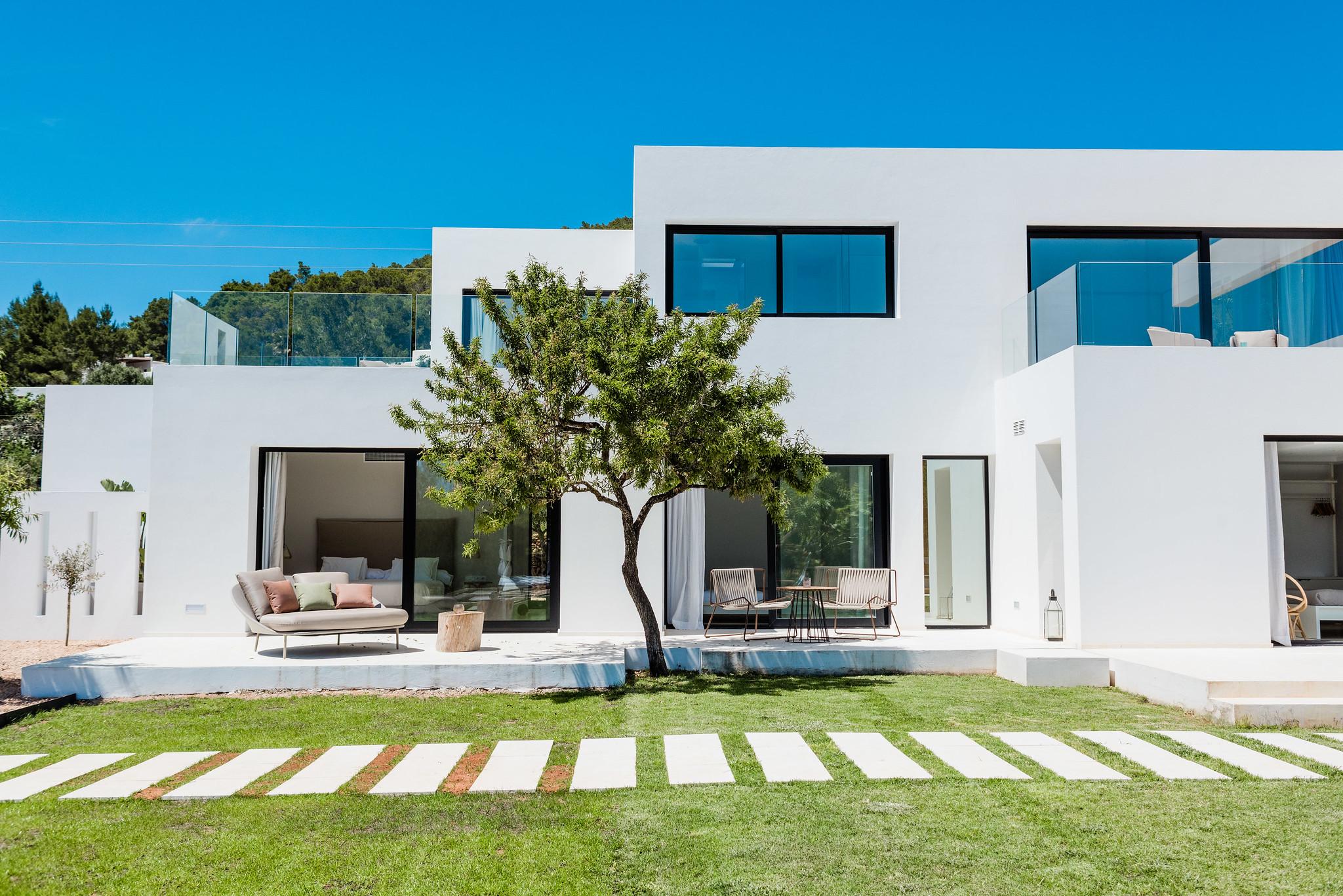 https://www.white-ibiza.com/wp-content/uploads/2020/06/white-ibiza-villas-can-carmen-exterior-house-view.jpg