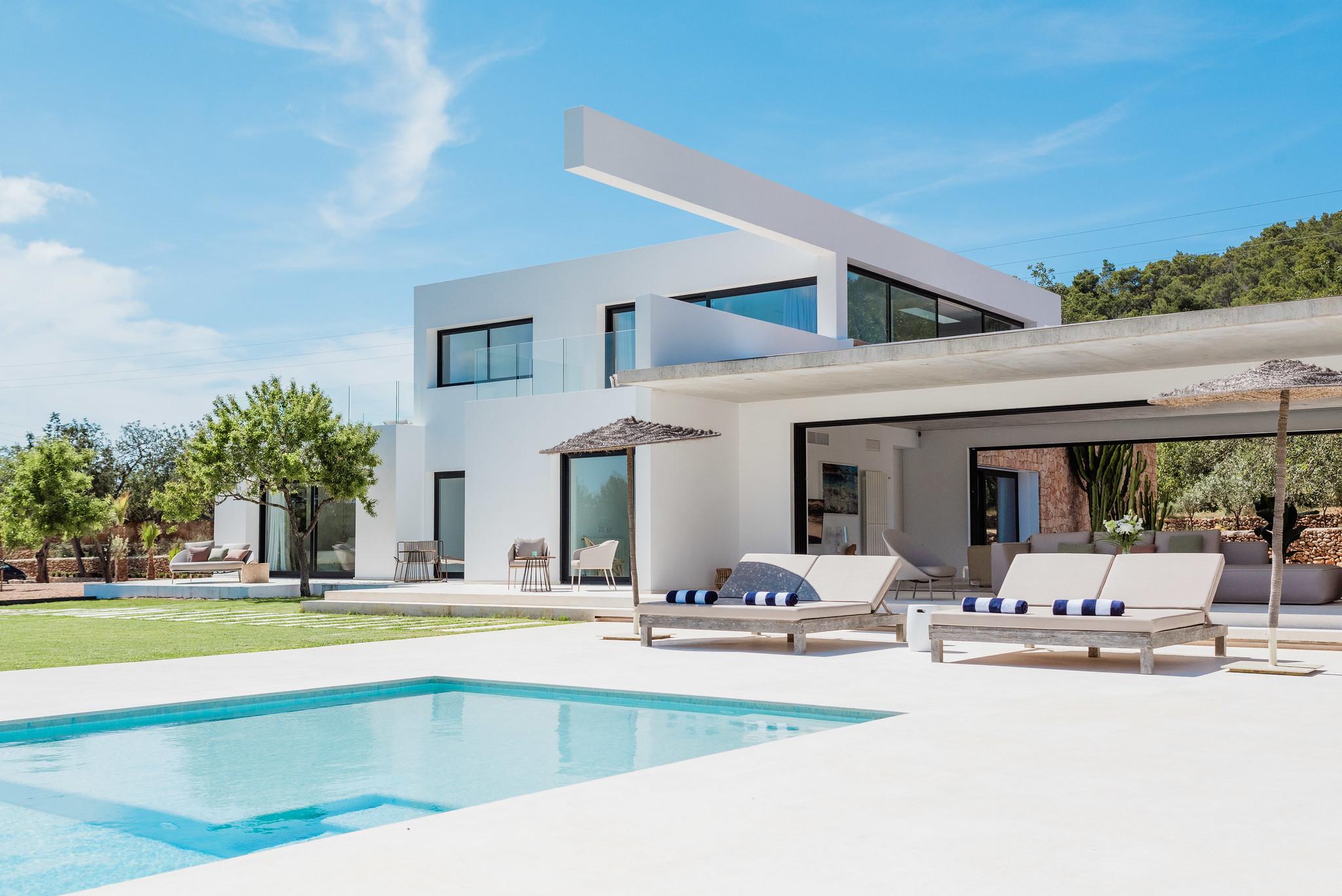 https://www.white-ibiza.com/wp-content/uploads/2020/06/white-ibiza-villas-can-carmen-exterior-view-from-pool.jpg