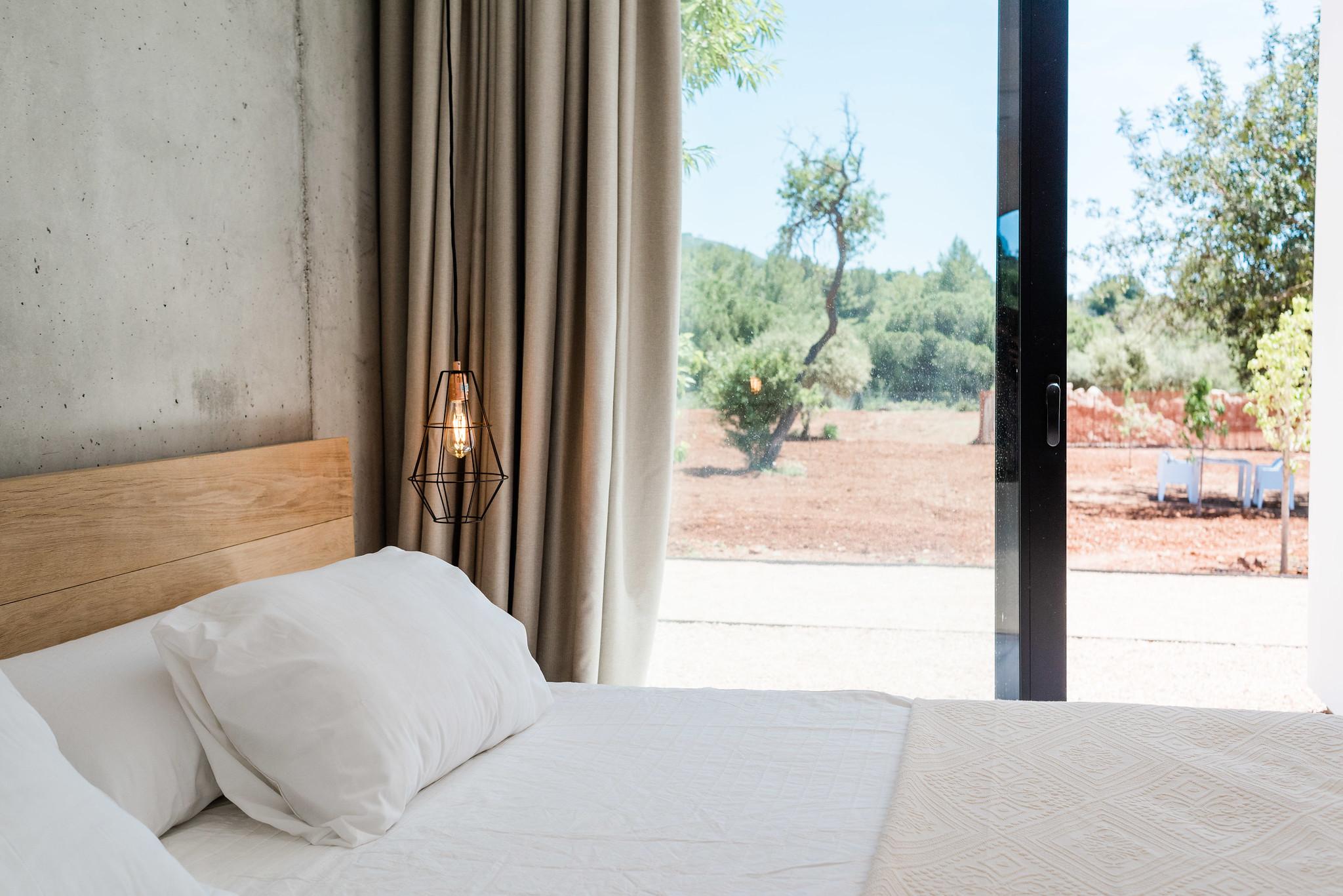 https://www.white-ibiza.com/wp-content/uploads/2020/06/white-ibiza-villas-can-carmen-interior-bedroom.jpg