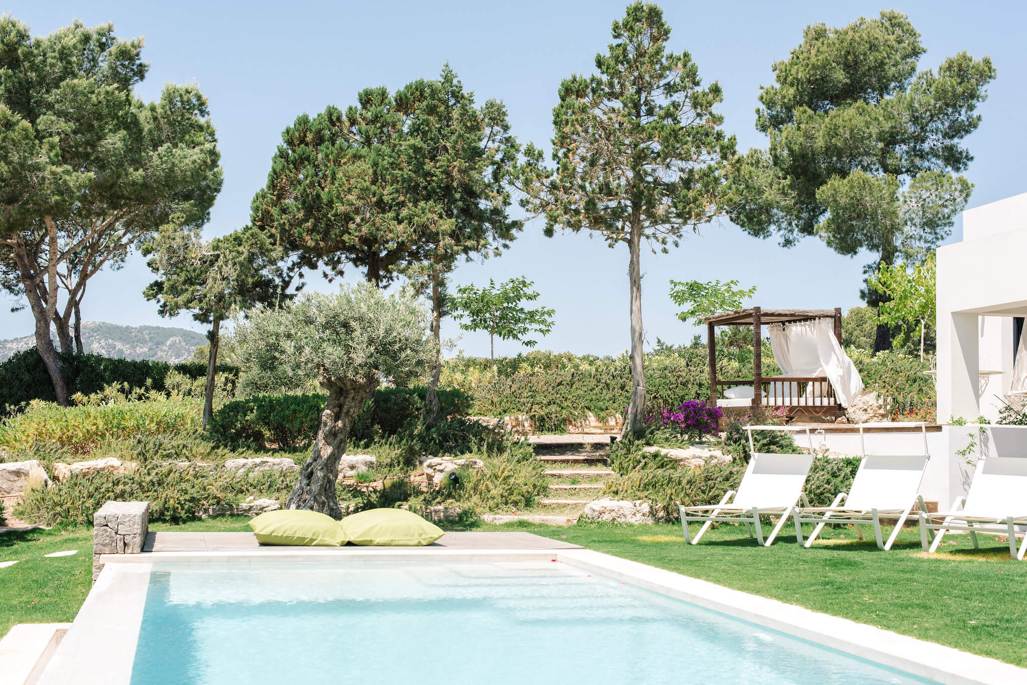 https://www.white-ibiza.com/wp-content/uploads/2020/06/white-ibiza-villas-can-jondal-exterior-pool-from-chillout.jpg