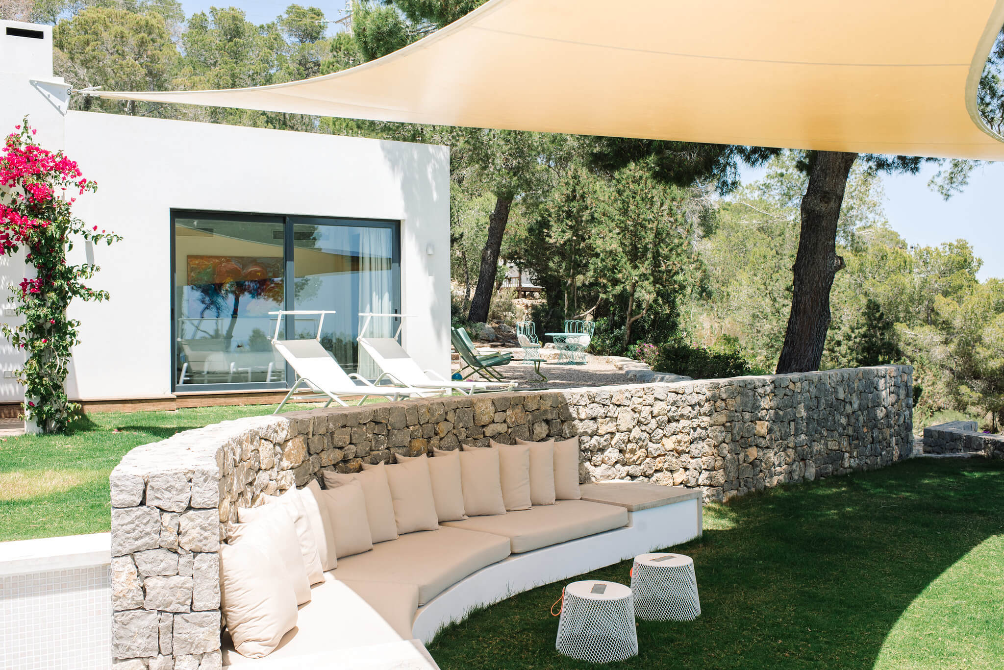 https://www.white-ibiza.com/wp-content/uploads/2020/06/white-ibiza-villas-can-jondal-exterior-shaded-chill-out.jpg