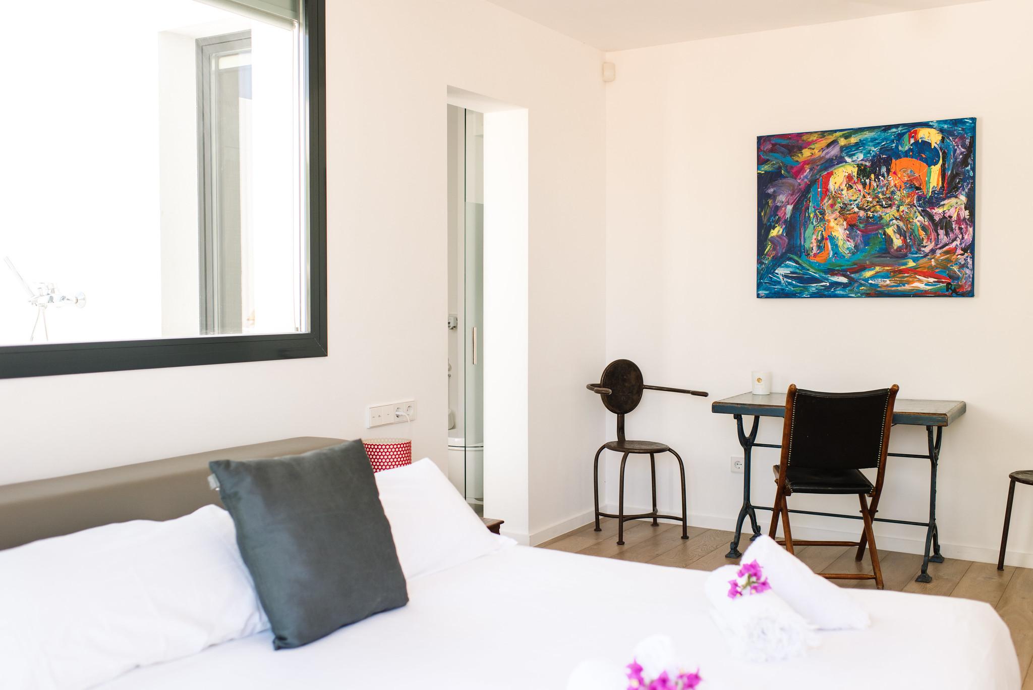 https://www.white-ibiza.com/wp-content/uploads/2020/06/white-ibiza-villas-can-jondal-interior-bedroom-1.jpg