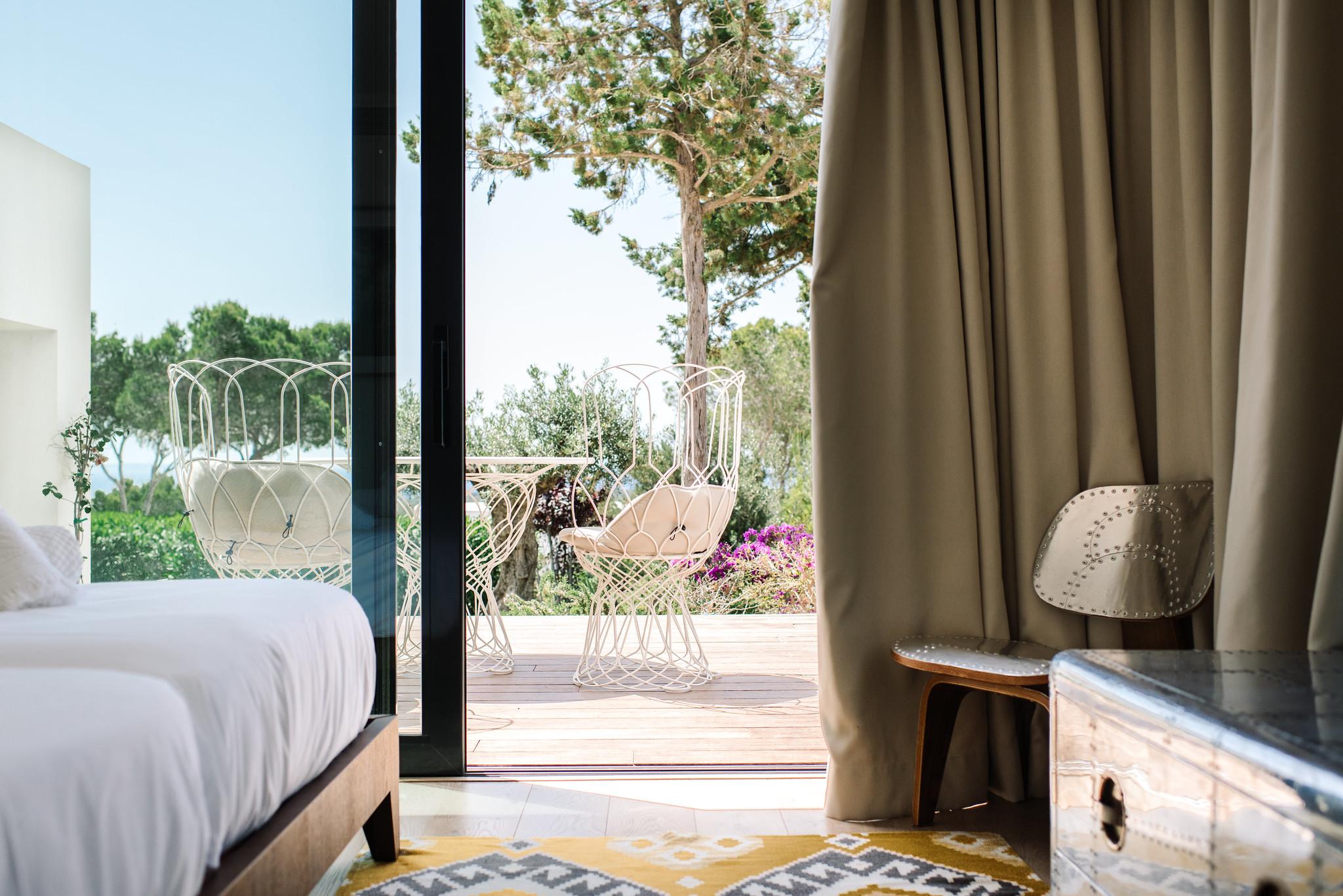 https://www.white-ibiza.com/wp-content/uploads/2020/06/white-ibiza-villas-can-jondal-interior-bedroom3-1.jpg