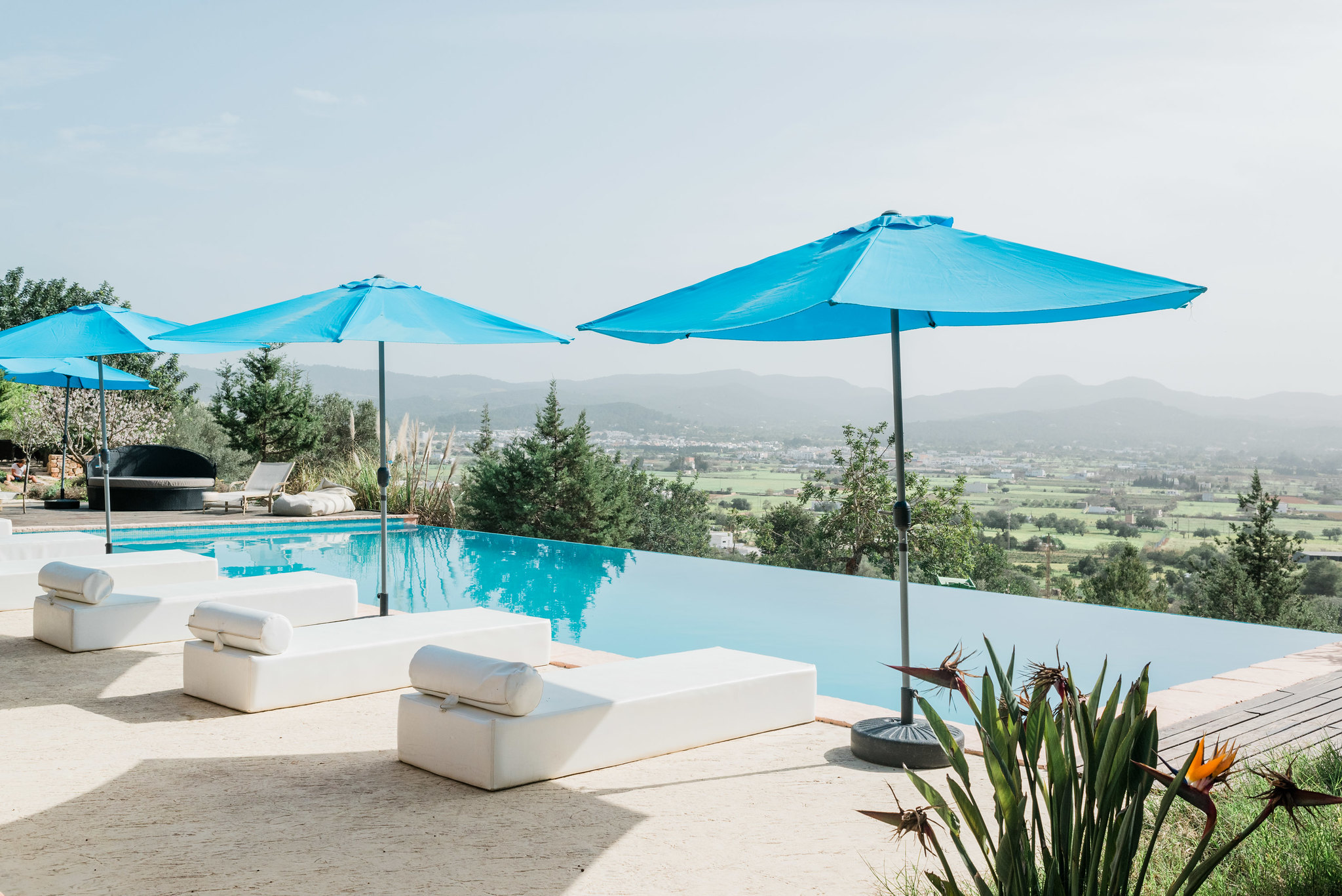 https://www.white-ibiza.com/wp-content/uploads/2020/06/white-ibiza-villas-los-corrales-exterior-pool-view.jpg