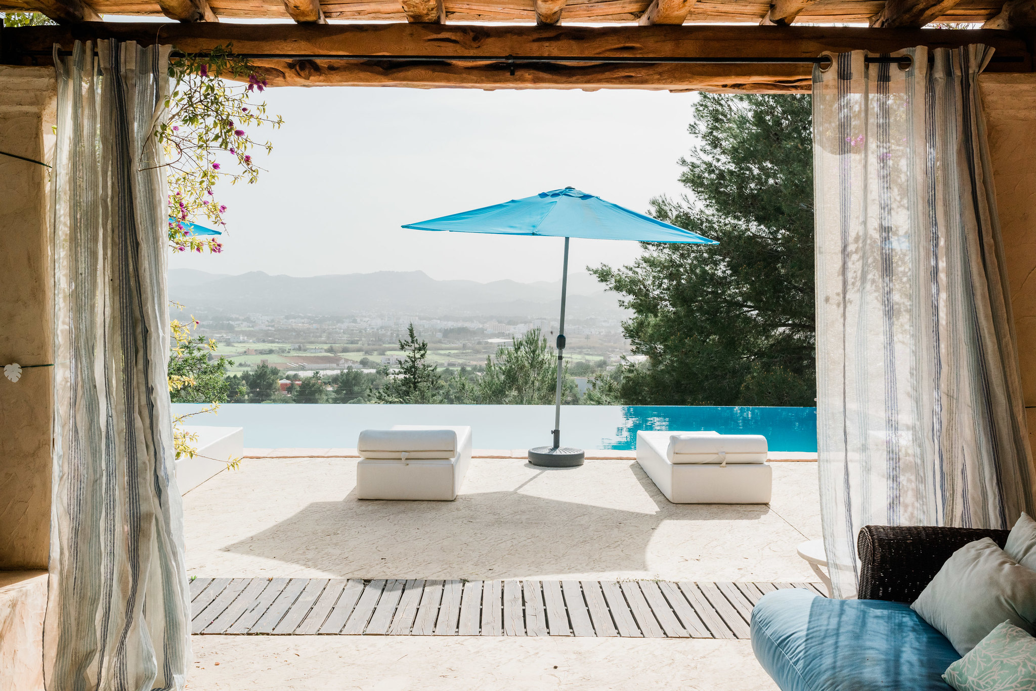 https://www.white-ibiza.com/wp-content/uploads/2020/06/white-ibiza-villas-los-corrales-exterior-view-from-chillout.jpg