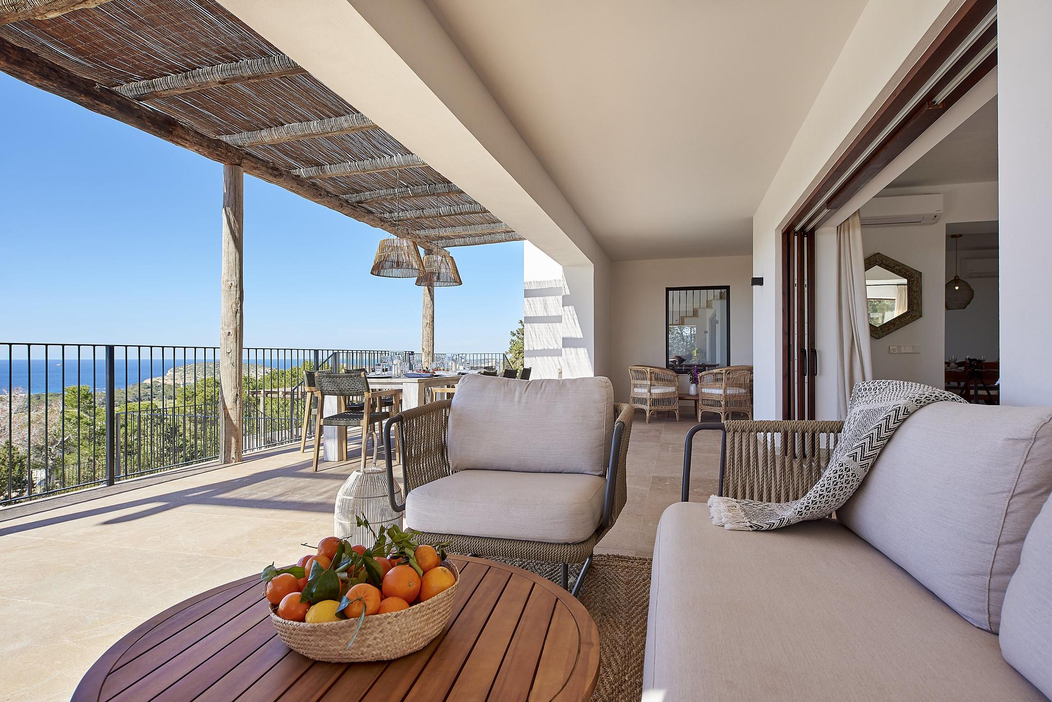 https://www.white-ibiza.com/wp-content/uploads/2020/06/white-ibiza-villas-sa-serra-exterior-terrace-seating.jpg