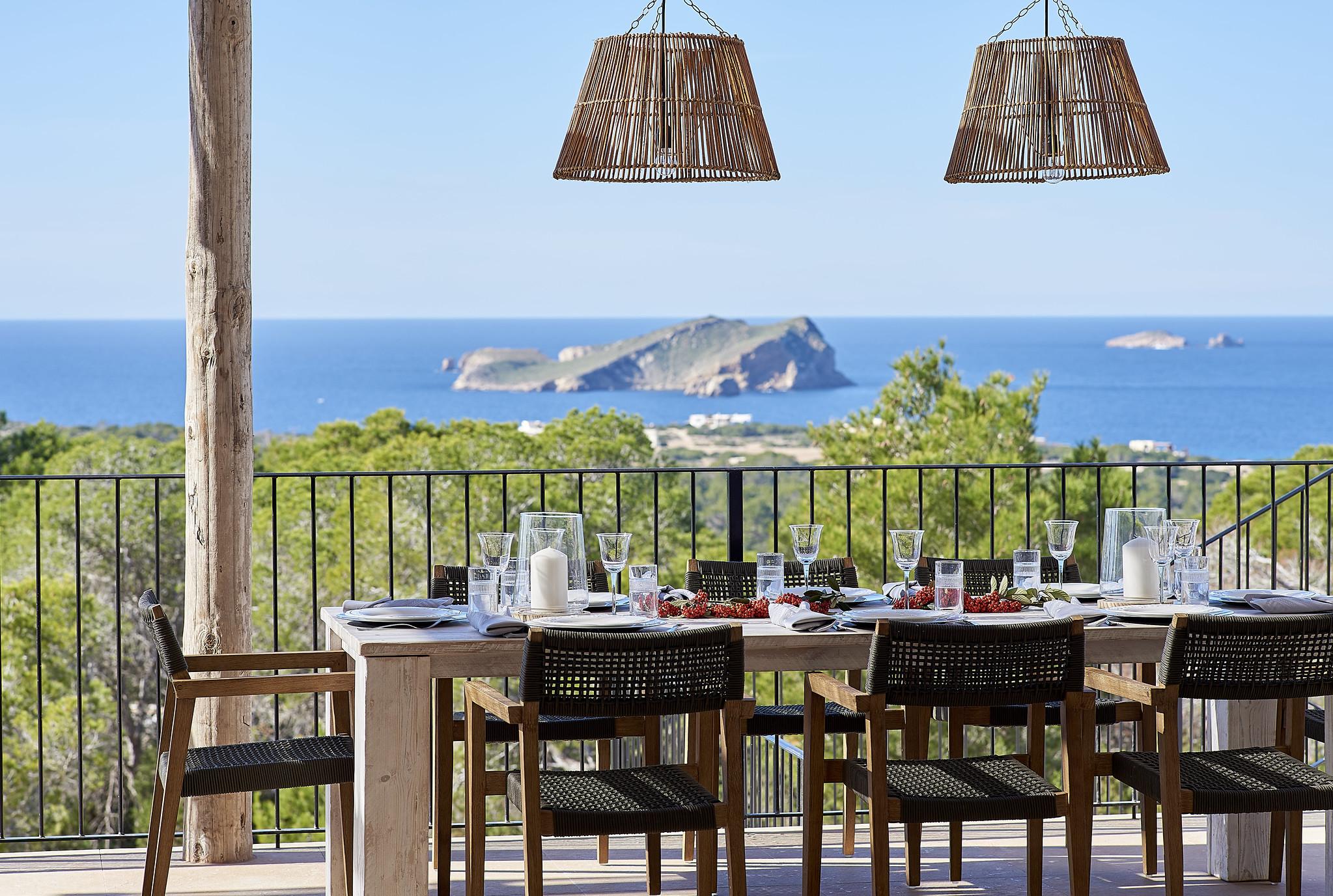 https://www.white-ibiza.com/wp-content/uploads/2020/06/white-ibiza-villas-sa-serra-exterior-view-table.jpg