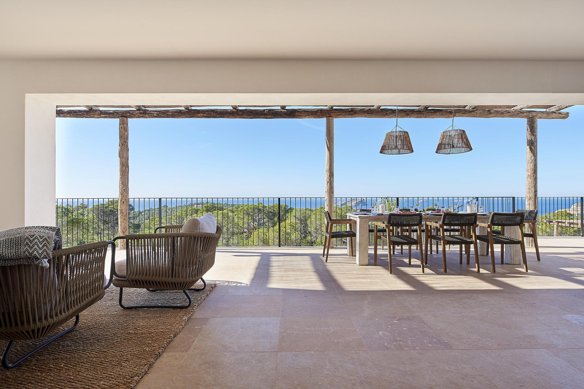 https://www.white-ibiza.com/wp-content/uploads/2020/06/white-ibiza-villas-sa-serra-interior-view-to-outside.jpg